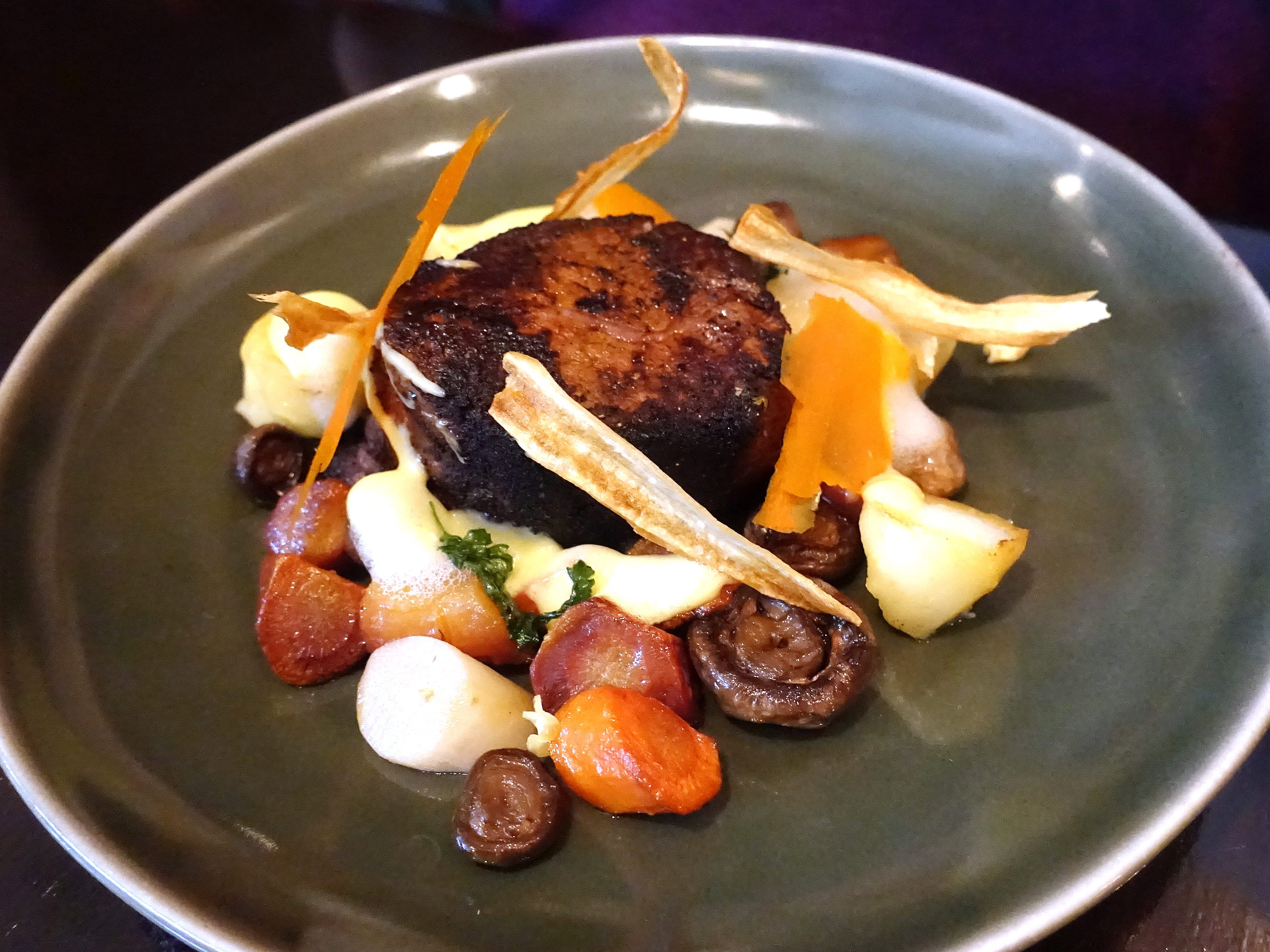 Blackened filet mignon with salsify, carrot, parsnip, button mushrooms and Hollandaise at Confluence in Carefree, AZ.