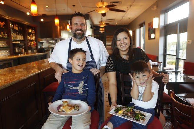 Chef Brandon Gauthier and his wife and house manager Victoria Gauthier with their children Jackson, 5, and Elijah, 2, at Confluence.