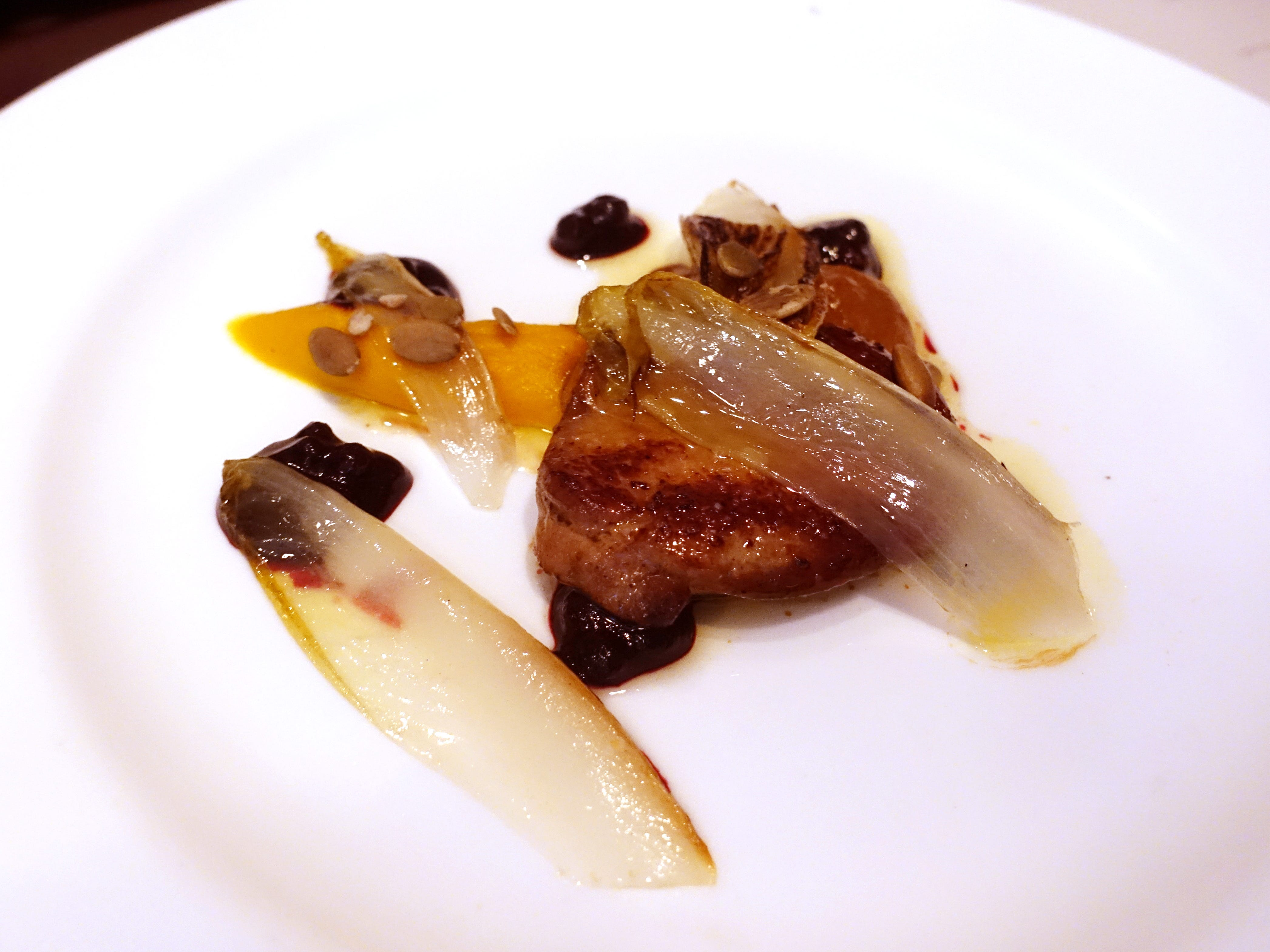 Seared foie gras with pumpkin, pepitas, huckleberry, endive and mole at Confluence in Carefree, AZ.