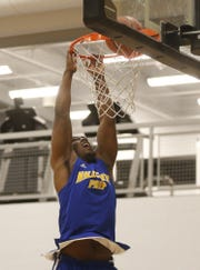 Hillcrest Prep North's Michael Rogers dunks during a warmup before a game against Taylor Made Prep.
