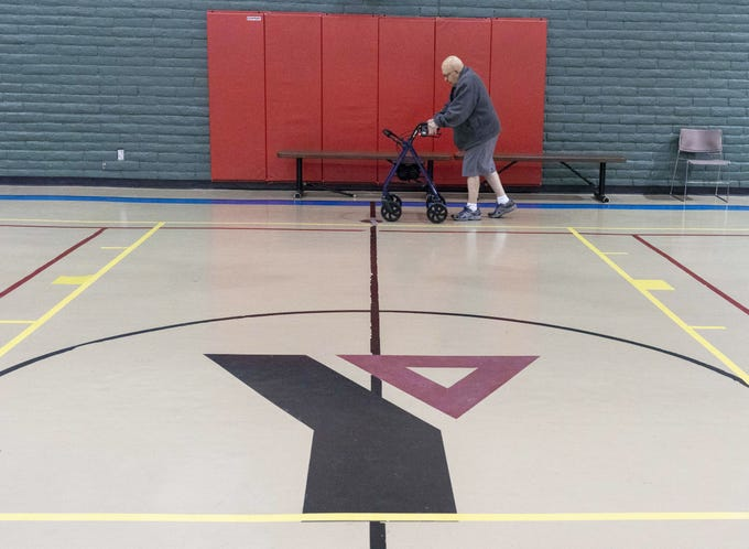 Dennis Suko, 75, walks around the basketball court at The Valley of the Sun YMCA. Mesa Family location is closing their doors on Dec 8th.