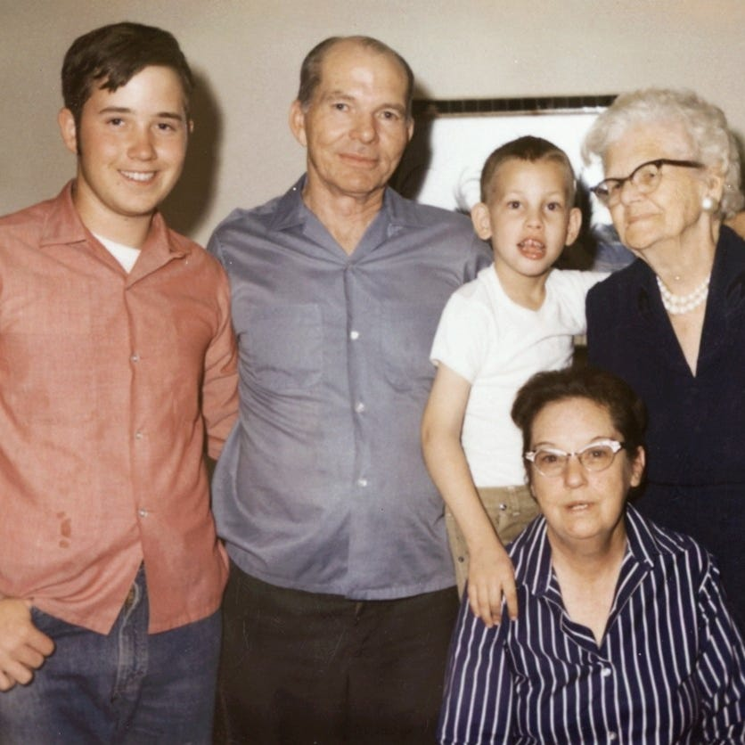 "Randall Howe, at age 5 or 6, with his adopted grandmother, ""Granny Tommie,"" his adopted parents, David and Marie Howe, and his adopted brother, David Mark."