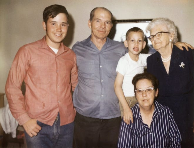 """Randall Howe, at age 5 or 6, with his adopted grandmother, """"Granny Tommie,"""" his adopted parents, David and Marie Howe, and his adopted brother, David Mark."""