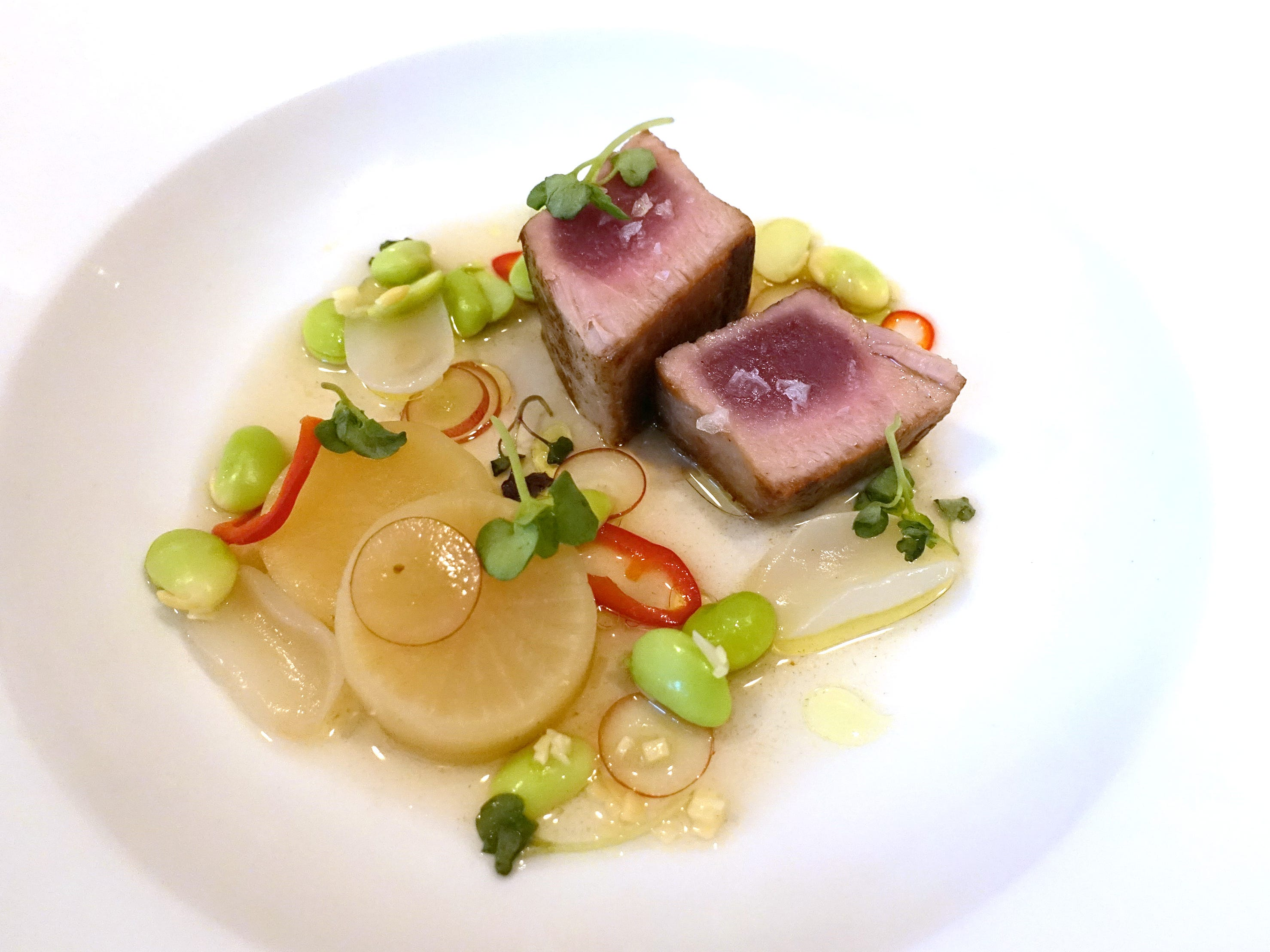 Seared tuna with rambutan, daikon, ginger, shiso, grapes and Fresno chiles at Confluence in Carefree, AZ.