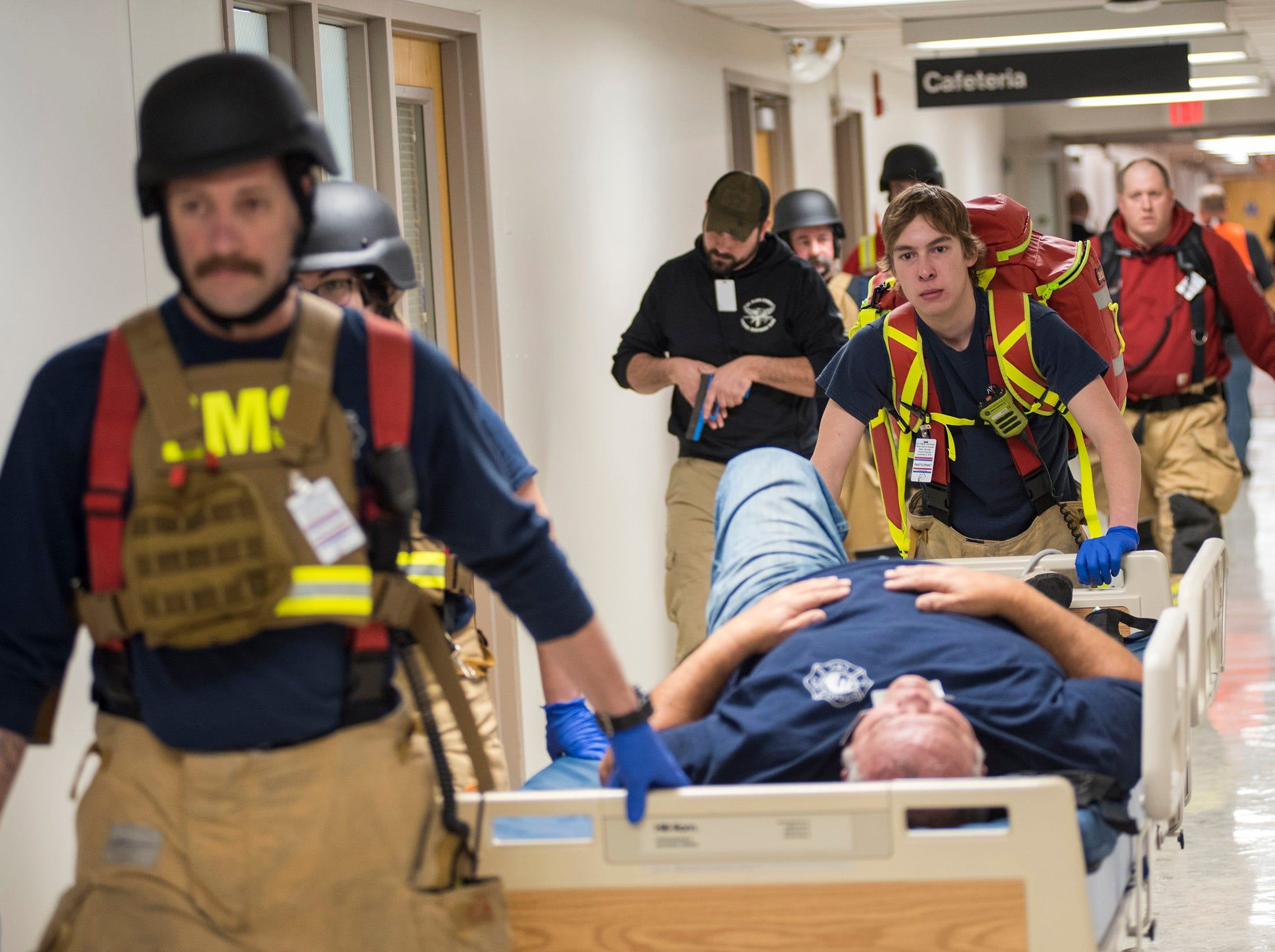Responders work to move a victim during an active shooter training drill Thursday, Dec. 6, 2018 at Ascension River District Hospital in East China.