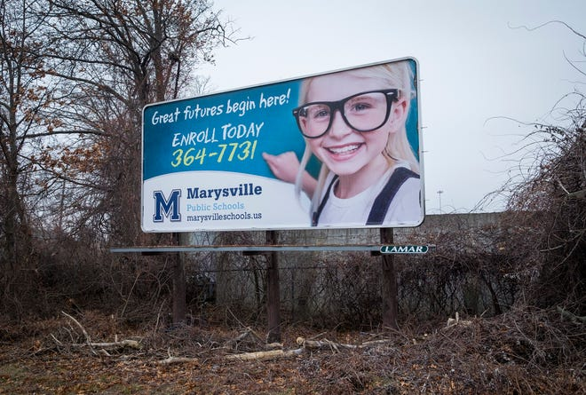 A billboard encouraging enrollment in Marysville Public Schools is seen near the intersection of Ravenswood Road and Electric Avenue. Billboards are one of the tools districts are using to attract students from other districts.