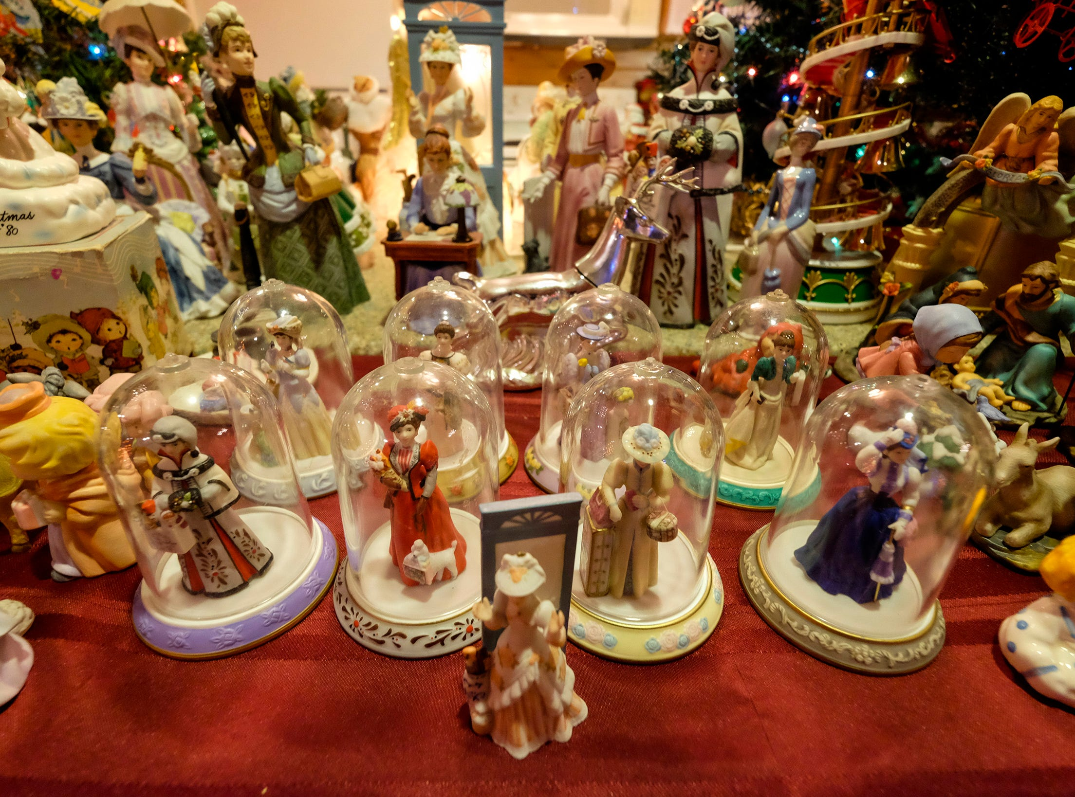 Figurines are arranged on a table for the annual History of the Christmas Tree Walk at Al and Diane Kodet's home in Algonac.