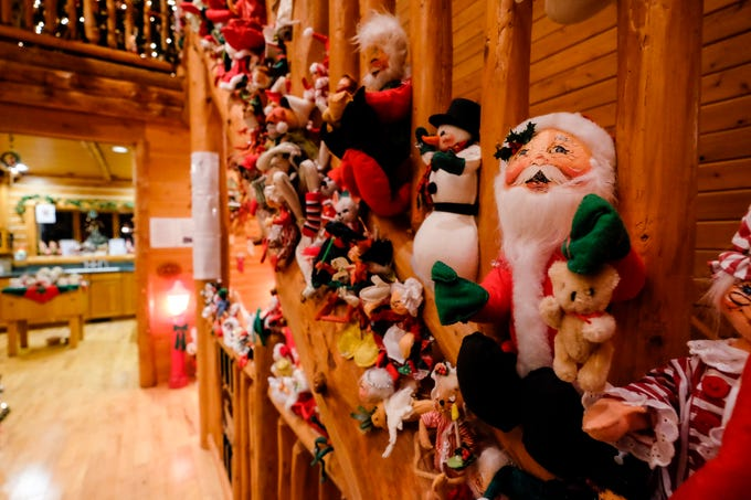 Christmas decorations line the stairwells in Al and Diane Kodet's Algonac home, where the annual History of the Christmas Tree Walk is held.