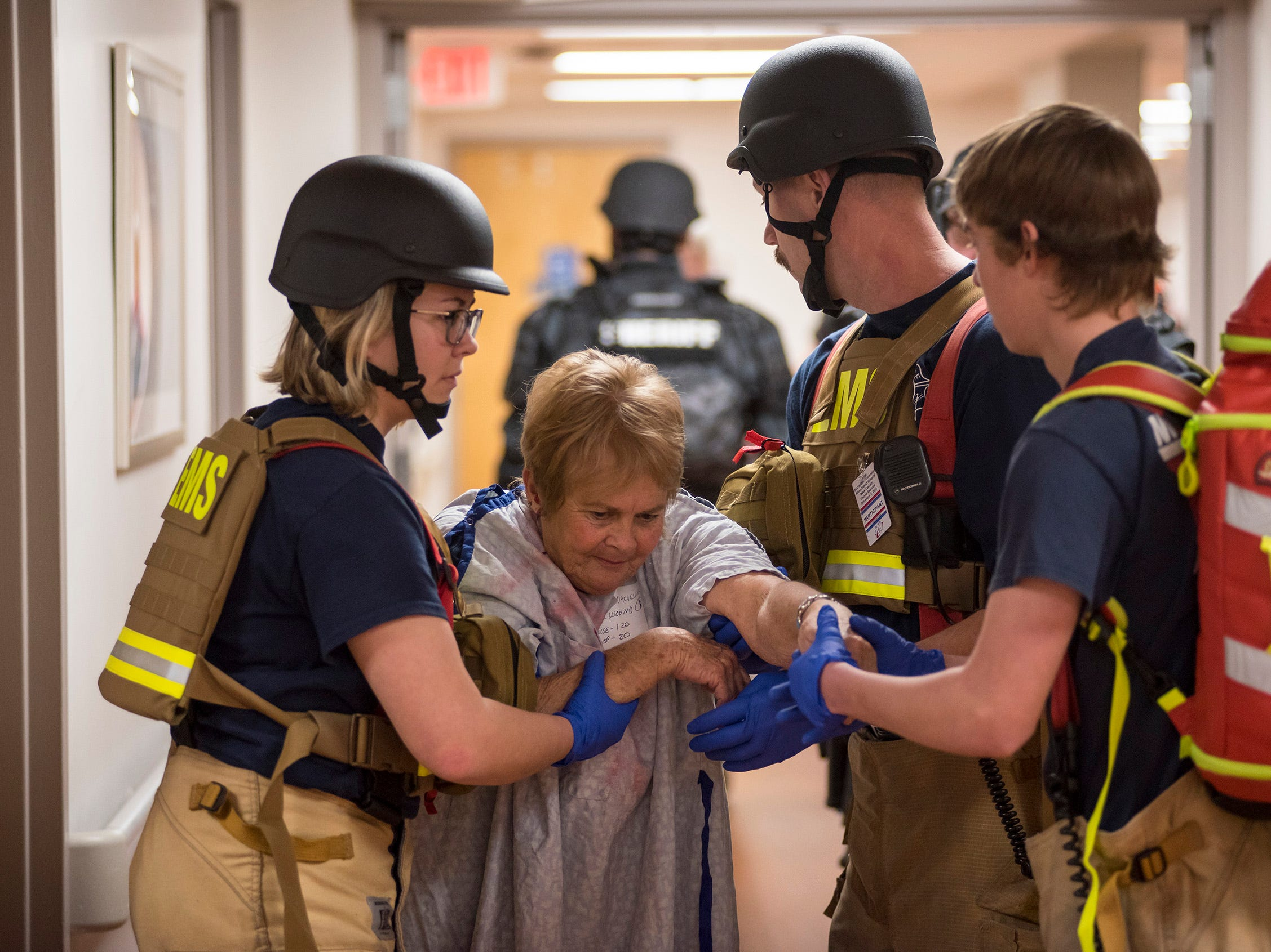 Responders help a gunshot victim during an active shooter training drill Thursday, Dec. 6, 2018 at Ascension River District Hospital in East China.