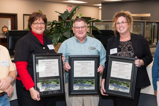 Former Fort Gratiot Treasurer Judi Reynolds, left, Clerk Rob Crawford and former Supervisor Jorja Baldwin hold certificates of appreciation from township staff in November 2016.