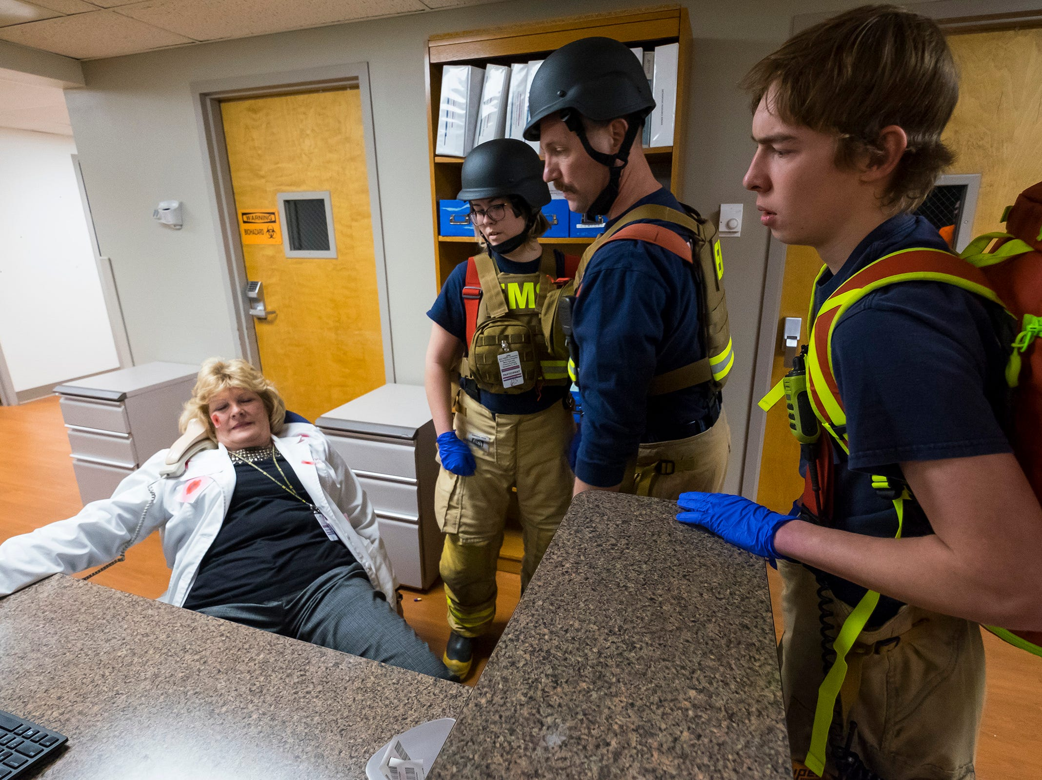 Responders check on a deceased victim during an active shooter training drill Thursday, Dec. 6, 2018 at Ascension River District Hospital in East China.