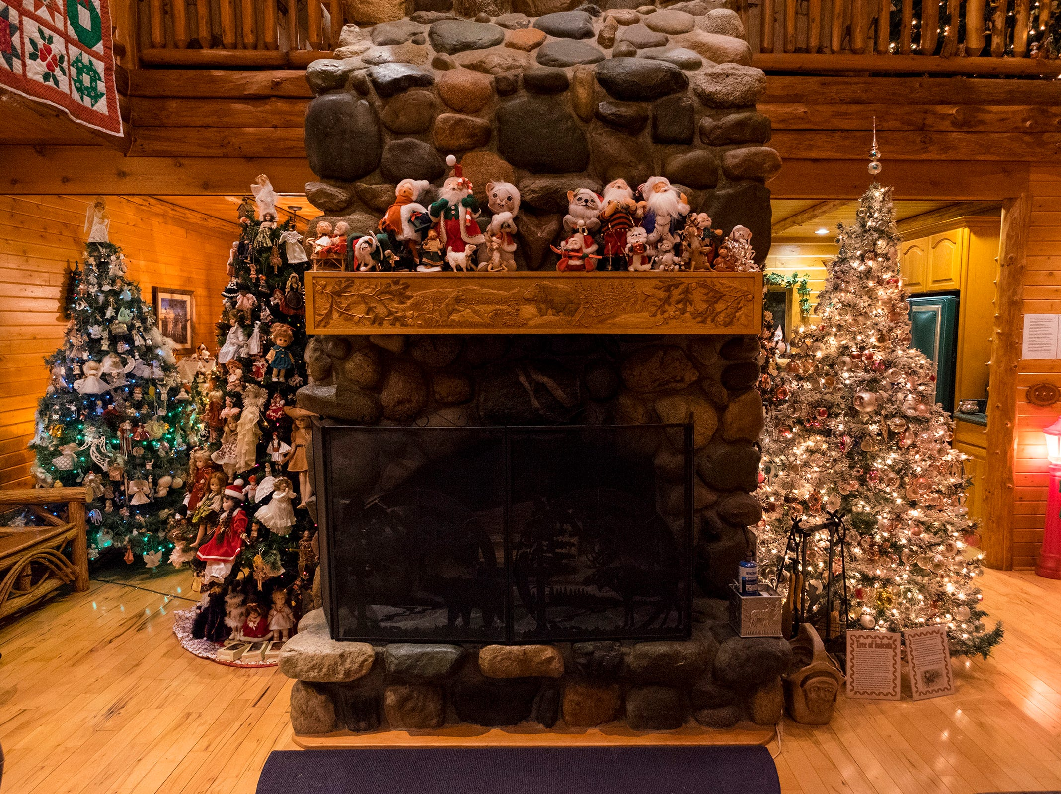 "Christmas decorations are arranged around the ""heart of the home,"" a rock shaped like a heart in the stone chimney of Al and Diane Kodet's Algonac home."