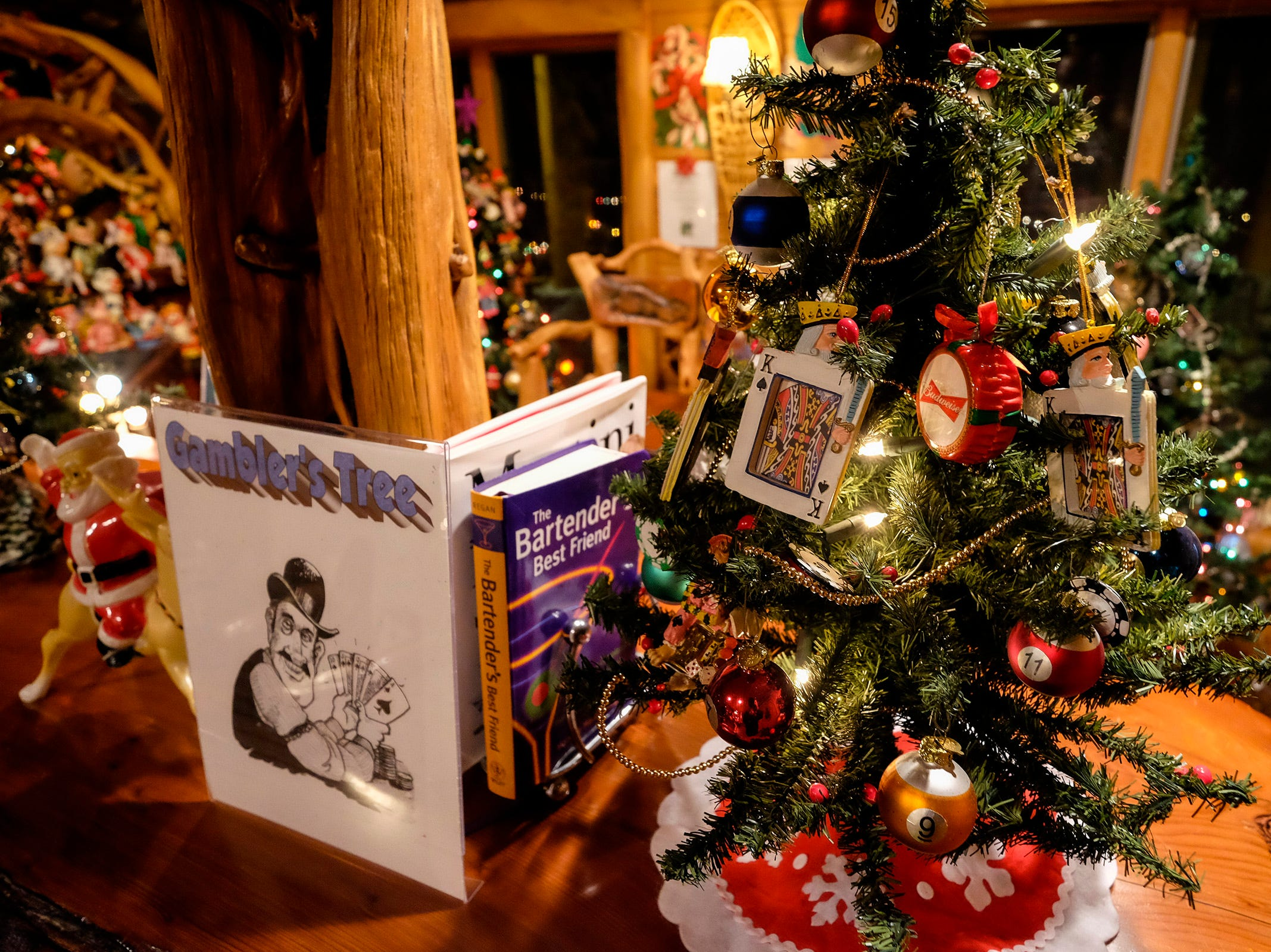 A gambling-themed Christmas tree sits on the bar in the basement of Al and Diane Kodet's home, where the annual History of the Christmas Tree Walk is held in Algonac.