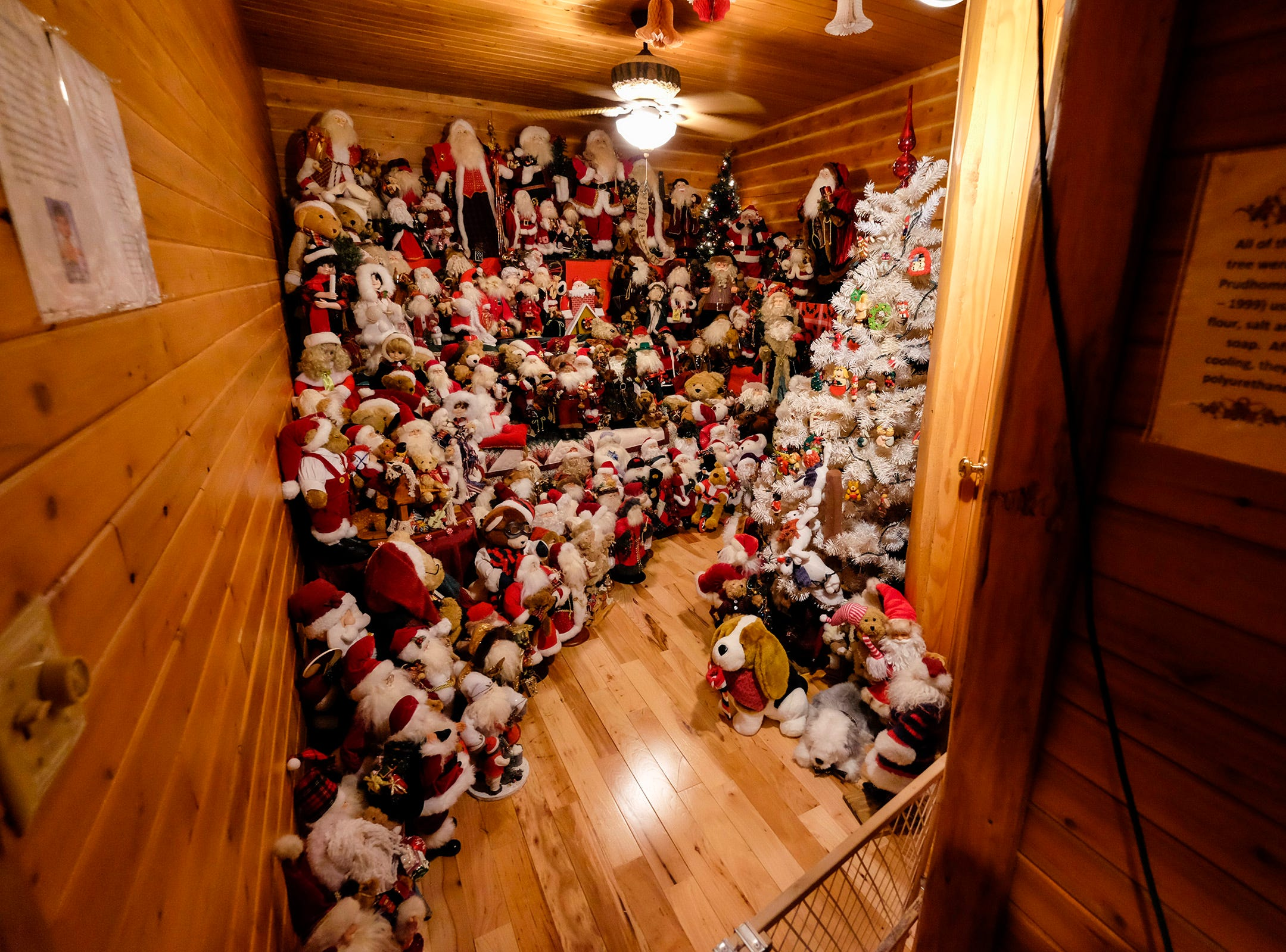 Handmade Santa Claus decorations fill a room for the annual History of the Christmas Tree Walk at Al and Diane Kodet's Algonac home.