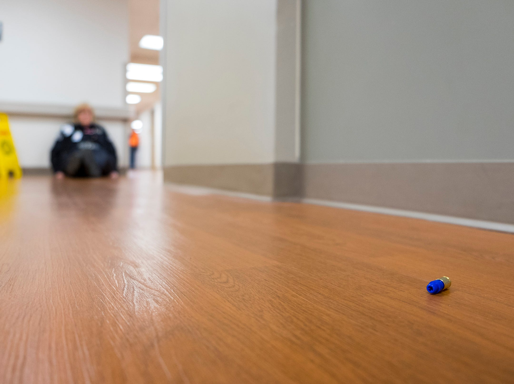 A training bullet lays on the floor in a hallway at Ascension River District Hospital during an active shooter training drill Thursday, Dec. 6, 2018.