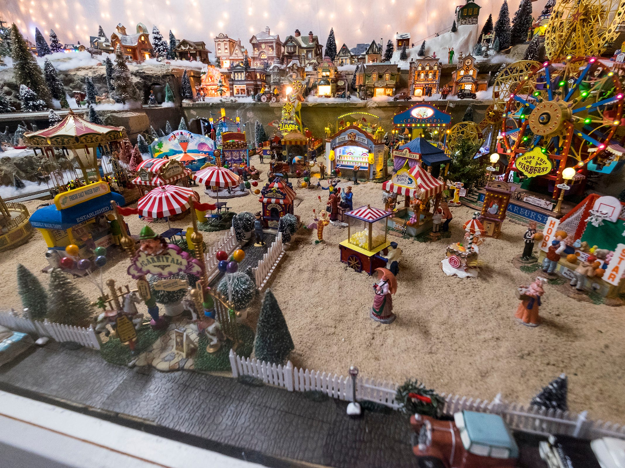 An animated Christmas village set up in the garage of Al and Diane Kodet's Algonac home is a new addition to this year's annual History of the Christmas Tree Walk.