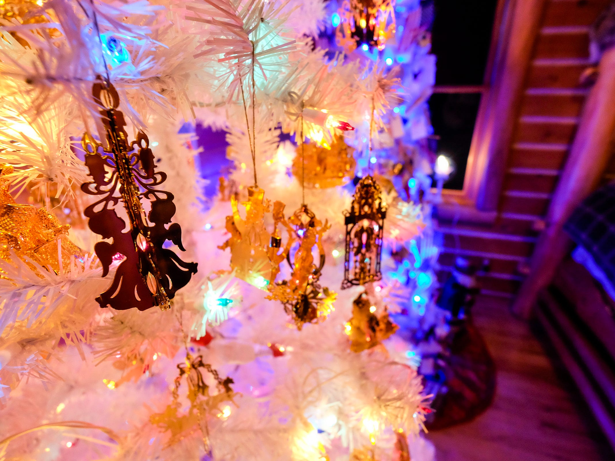 Decorations hang on themed Christmas trees at the annual History of the Christmas Tree Walk at Al and Diane Kodet's home in Algonac.