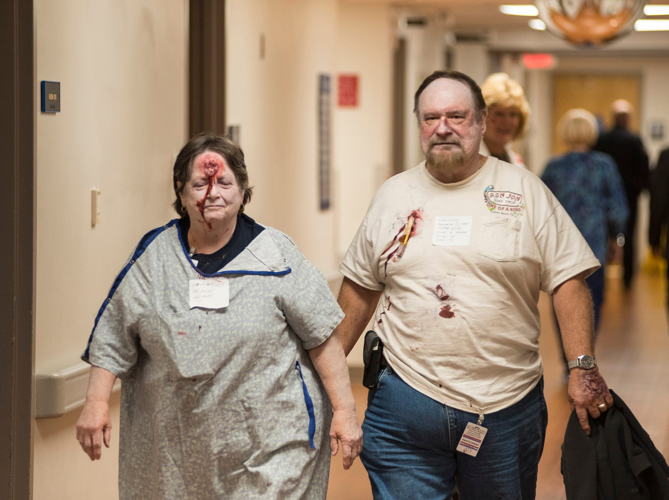 Participants dressed as gunshot victims walk through the hallway of Ascension River District Hospital in East China Thursday, Dec. 6, 2018 after an active shooter drill.
