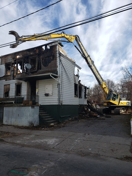 61 Academy Street in the City of Poughkeepsie is demolished by a crew from High Ground Industrial on December 5, 2018.