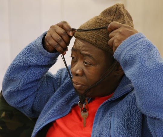 Hartencia Grant returns the key to her apartment around her neck while at Dutchess Outreach's The Lunch Box in the City of Poughkeepsie on December 4, 2018. Grant, who was homeless for a few months in 2016, keeps the keys to her apartment around her neck to keep them safe.