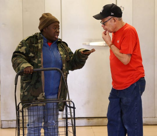 Hartencia Grant speaks with Rene Otero a volunteer at The Lunch Box before heading out in the City of Poughkeepsie on December 4, 2018.