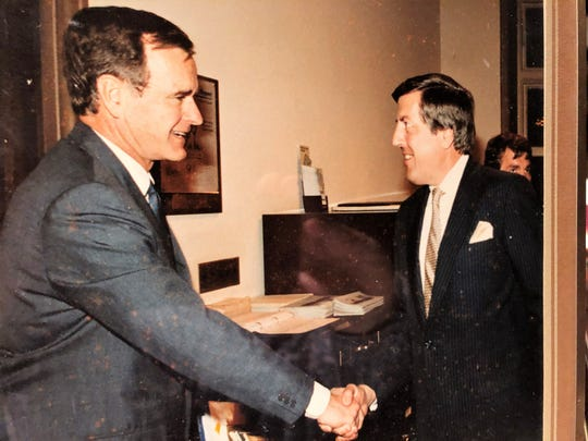 Richard Lesher shakes hands with George H.W. Bush while he was President of the United States. Lesher, who retired to Franklin County, served as president of the U.S. Chamber of Commerce from 1975 to 1997.