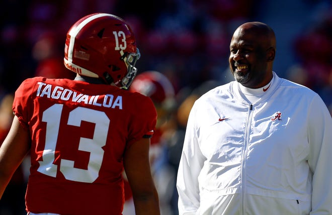 Alabama quarterback Tua Tagovailoa (13) talks with Alabama offensive coordinator Mike Locksley before the start of a game against Mississippi State. Locksley has been hired as Maryland's new head football coach. (AP Photo/Butch Dill)