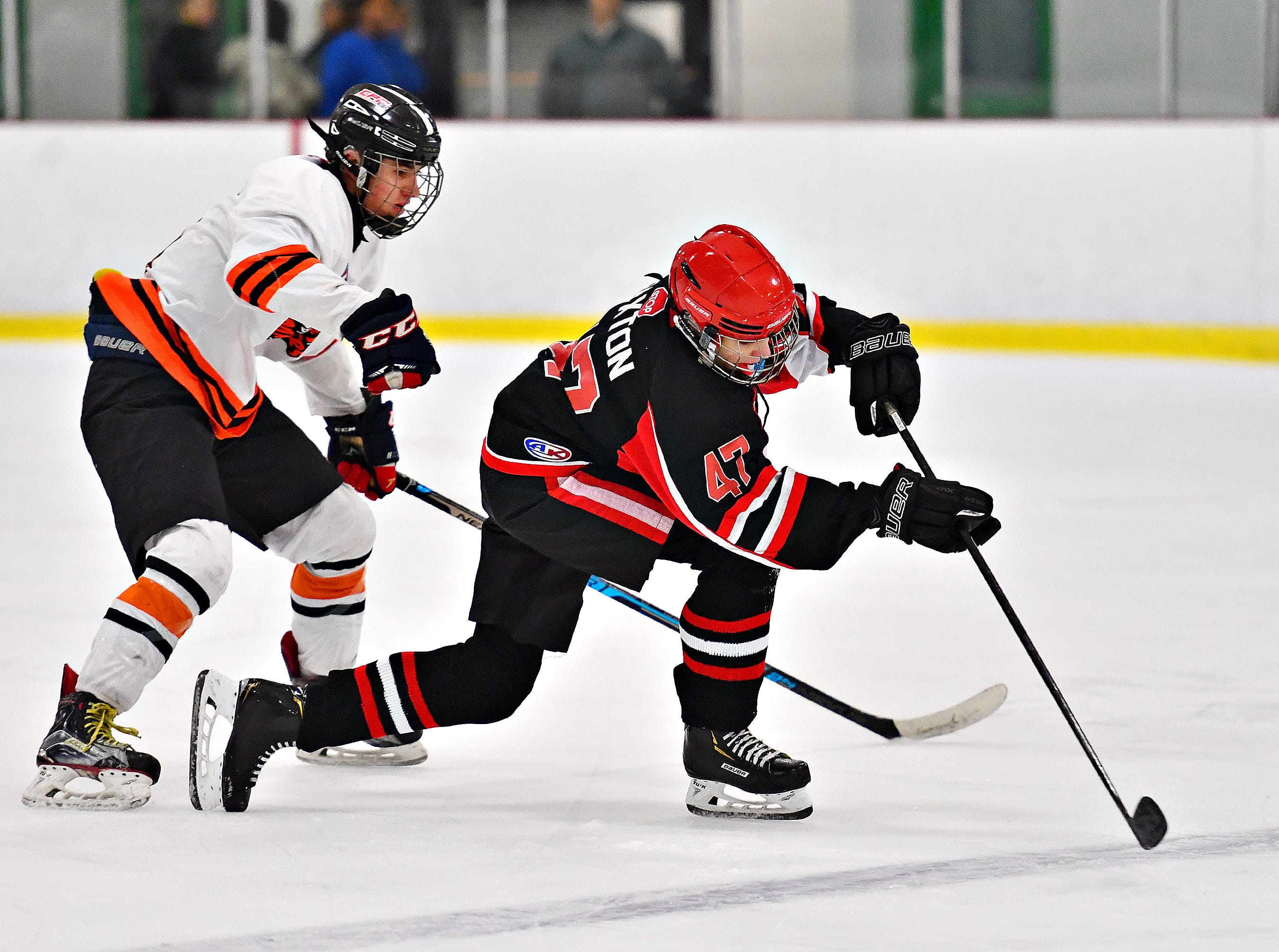 Cumberland Valley's Carson Paxton, right, controls the puck while Central York's Sean Barba defends during ice hockey action at York Ice Arena in York City, Wednesday, Dec. 5, 2018. Dawn J. Sagert photo