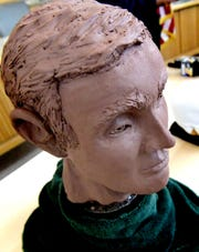 A clay model of a homicide victim known as West Manchester John Doe created by Penn State forensic artist Jenny Kenyon was on display during press conference at the West Manchester Township building Thursday, Dec. 6, 2018. Investigators are looking for the public's help to identify the victim, whose skeletal remains were found off Loucks Road in the township in 2013.  (Bill Kalina photo)