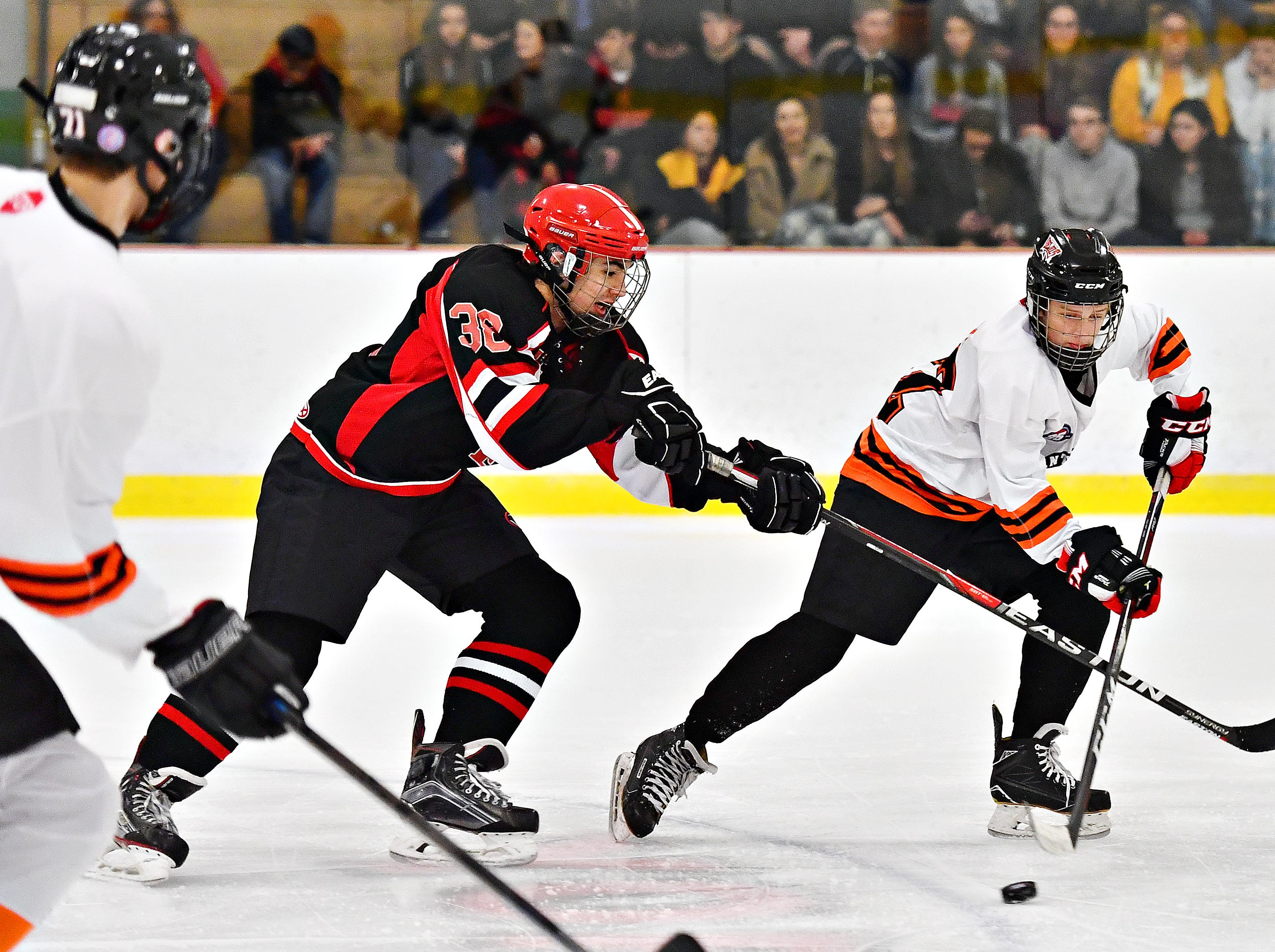 Central York's Mason Steward, right, works to control the puck while Cumberland Valley's Cole Thayer defends during ice hockey action at York Ice Arena in York City, Wednesday, Dec. 5, 2018. Dawn J. Sagert photo