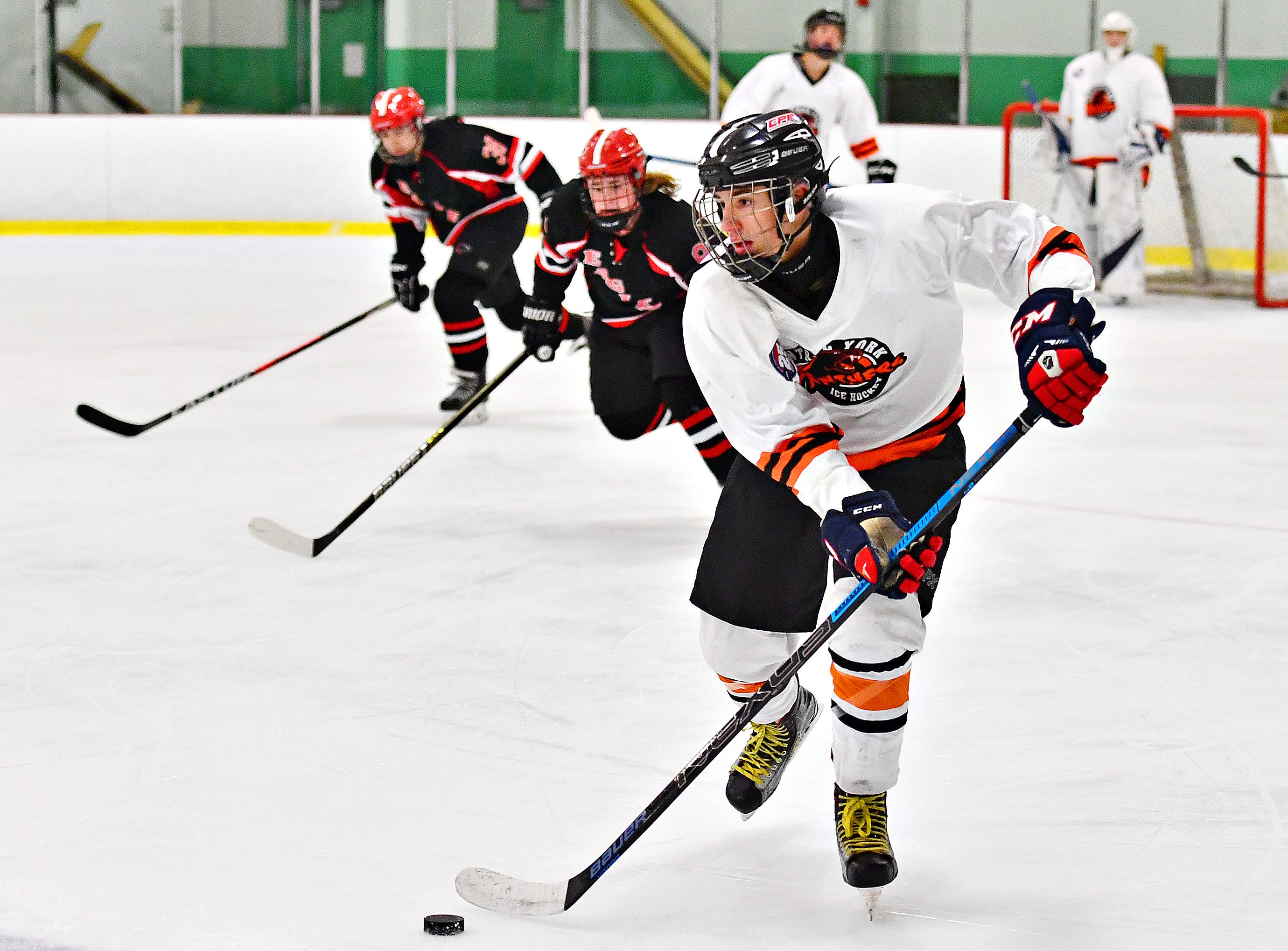 Central York's Sean Barba drives the puck across the ice during ice hockey action against Cumberland Valley at York Ice Arena in York City, Wednesday, Dec. 5, 2018. Dawn J. Sagert photo