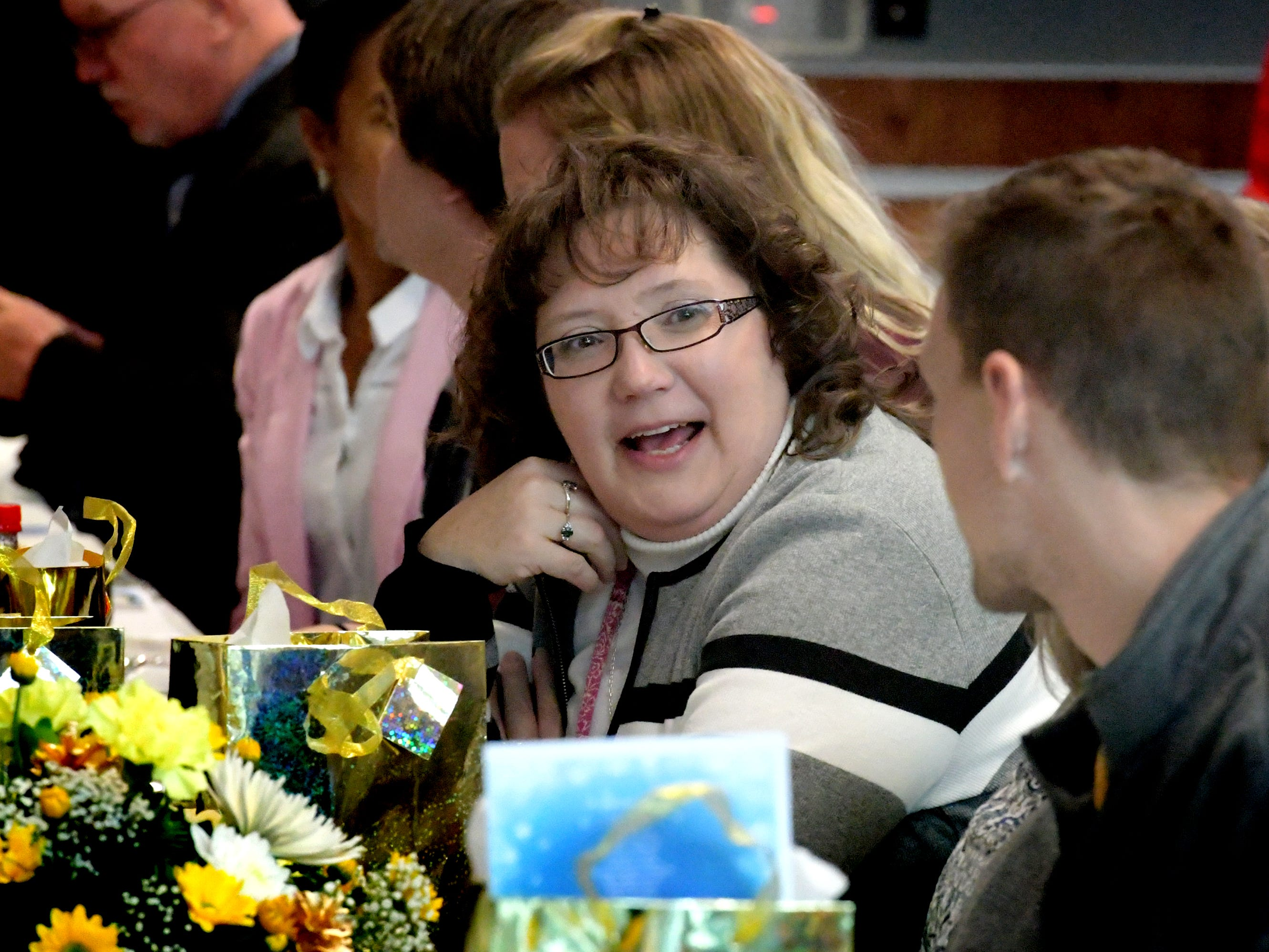 "City school teachers visit during an awards ceremony for city teachers at the York City School District Administration Building Thursday, Dec. 6, 2018. According to the Pennsylvania Value Added Assessment, York City students throughout the district exceeded the standard for PA Academic Growth. ""Shining Star"" teachers were recognized during the event. Bill Kalina photo"