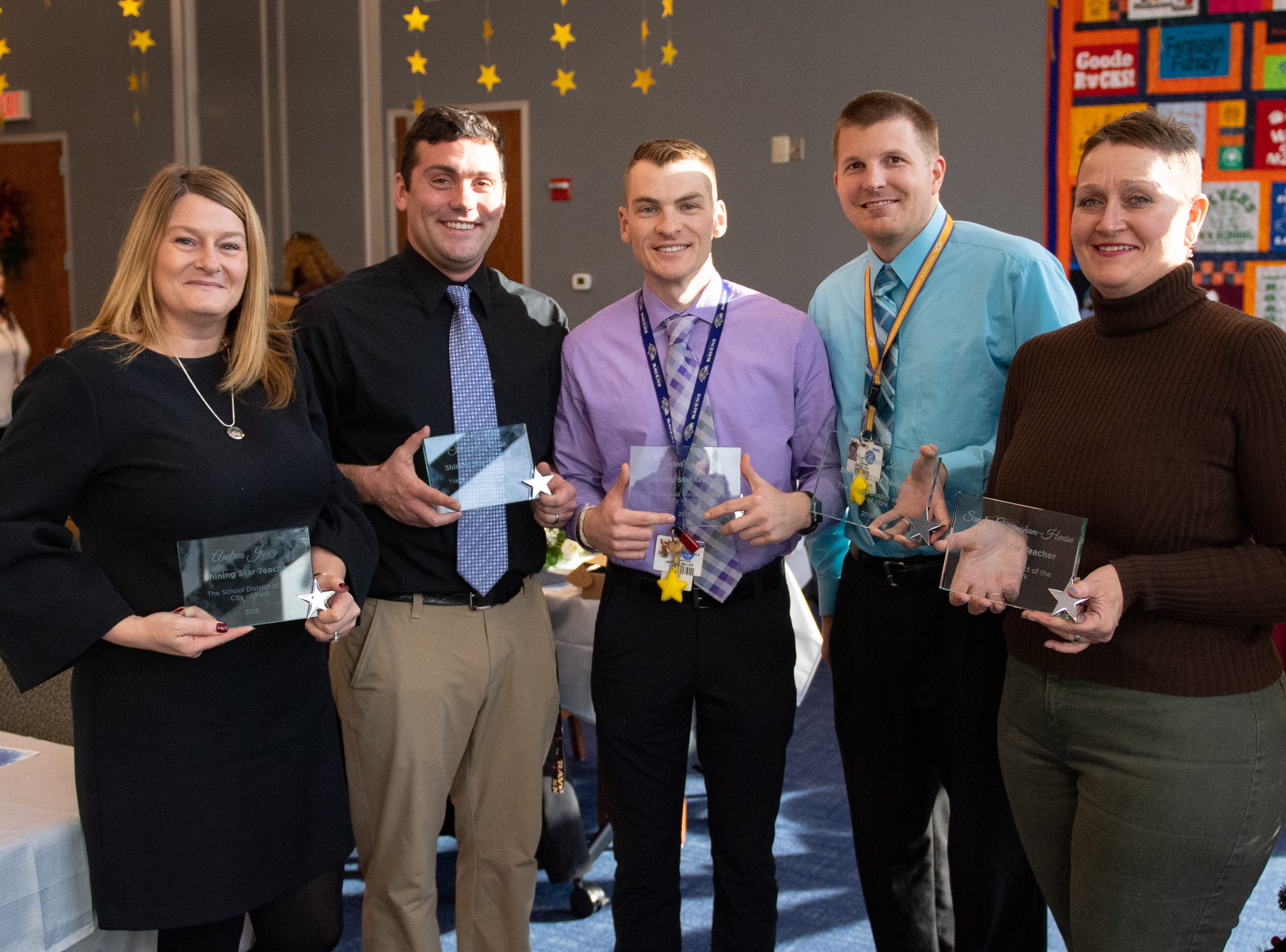 (Left to right) Andrea Josey, Chris Giese, Jared Miller, Jonas Lau and Sandy Cunningham-Henise of Jackson proudly show off their awards, December 6, 2018.