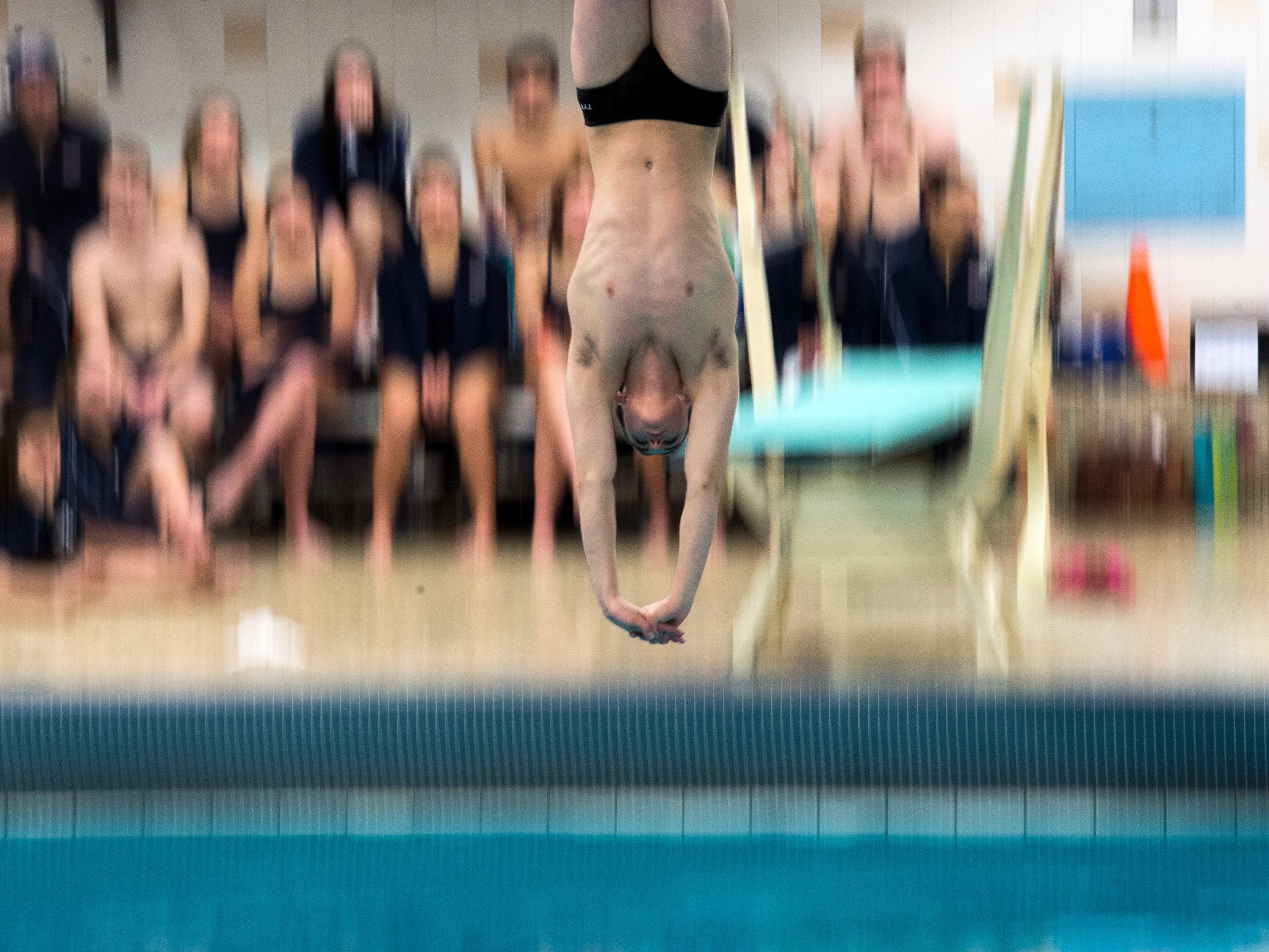 South Western divers compete during New Oxford's senior night at South Western, Thursday, Jan. 4, 2018. The South Western Mustangs beat the New Oxford Colonials, 121-59 for the boys; 104-79 for the girls.