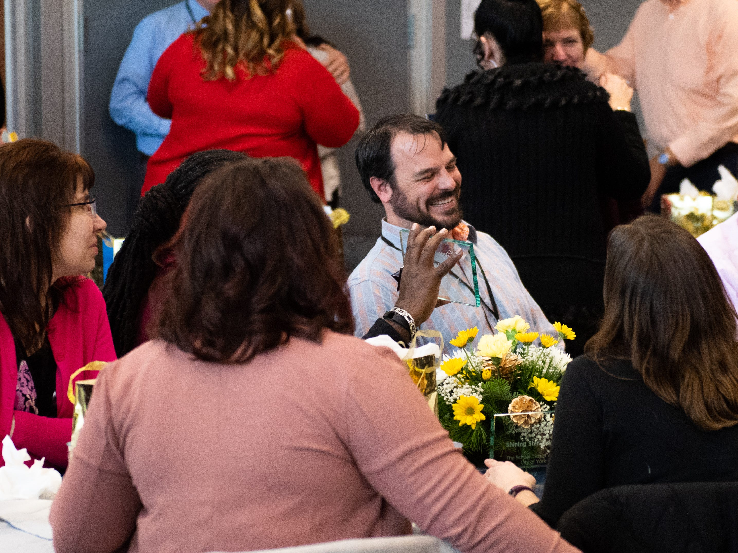 Jim Sieling, a teacher at Edgar Fahs Smith STEAM Academy, and the rest of his fellow Shining Stars are all smiles after receiving their hard earned awards, December 6, 2018.