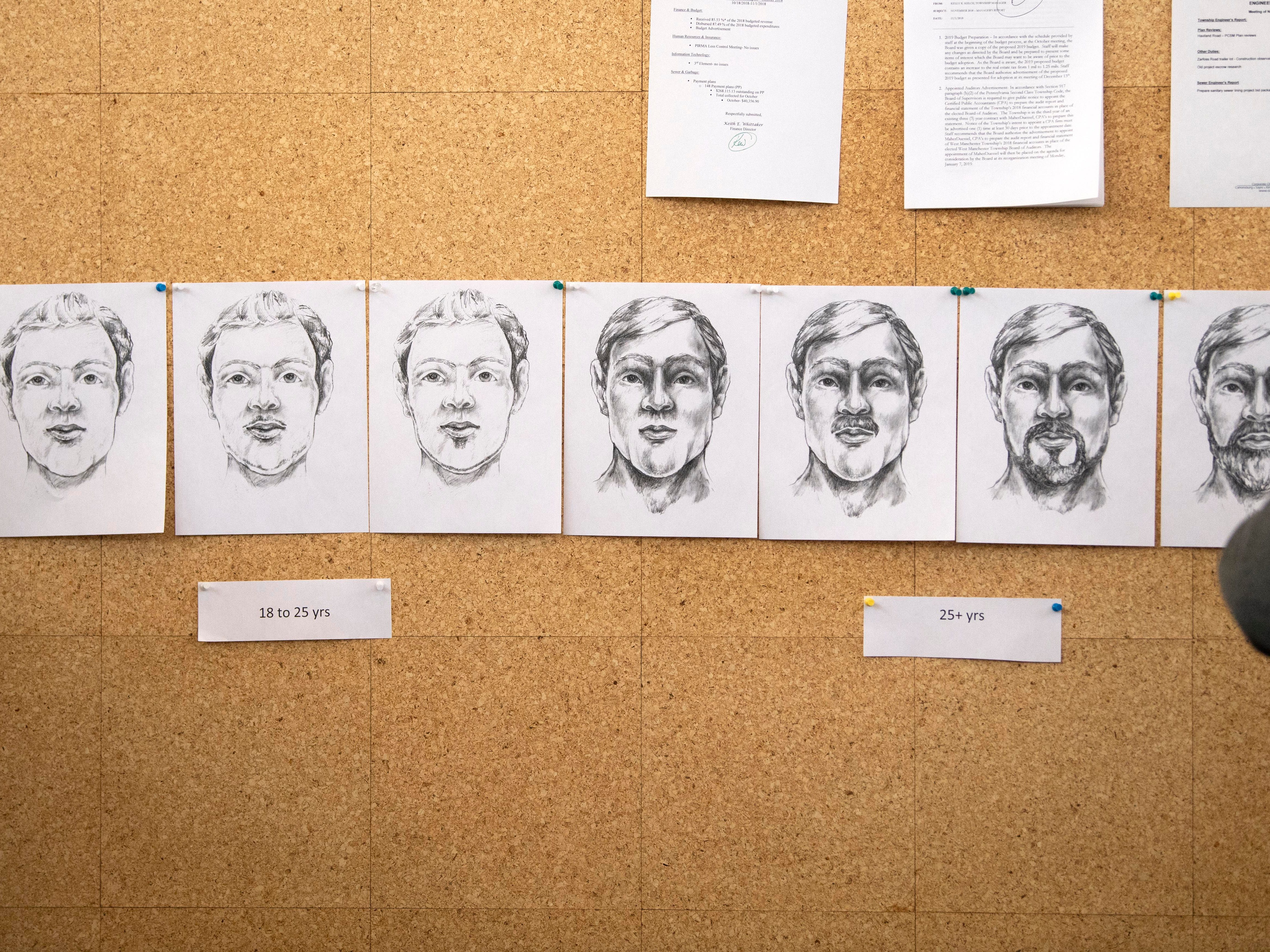 Sketches, depicting what the victim of a 2013 cold case might look like, hang on a wall during a press conference at West Manchester Township building, Thursday, Dec. 6, 2018.