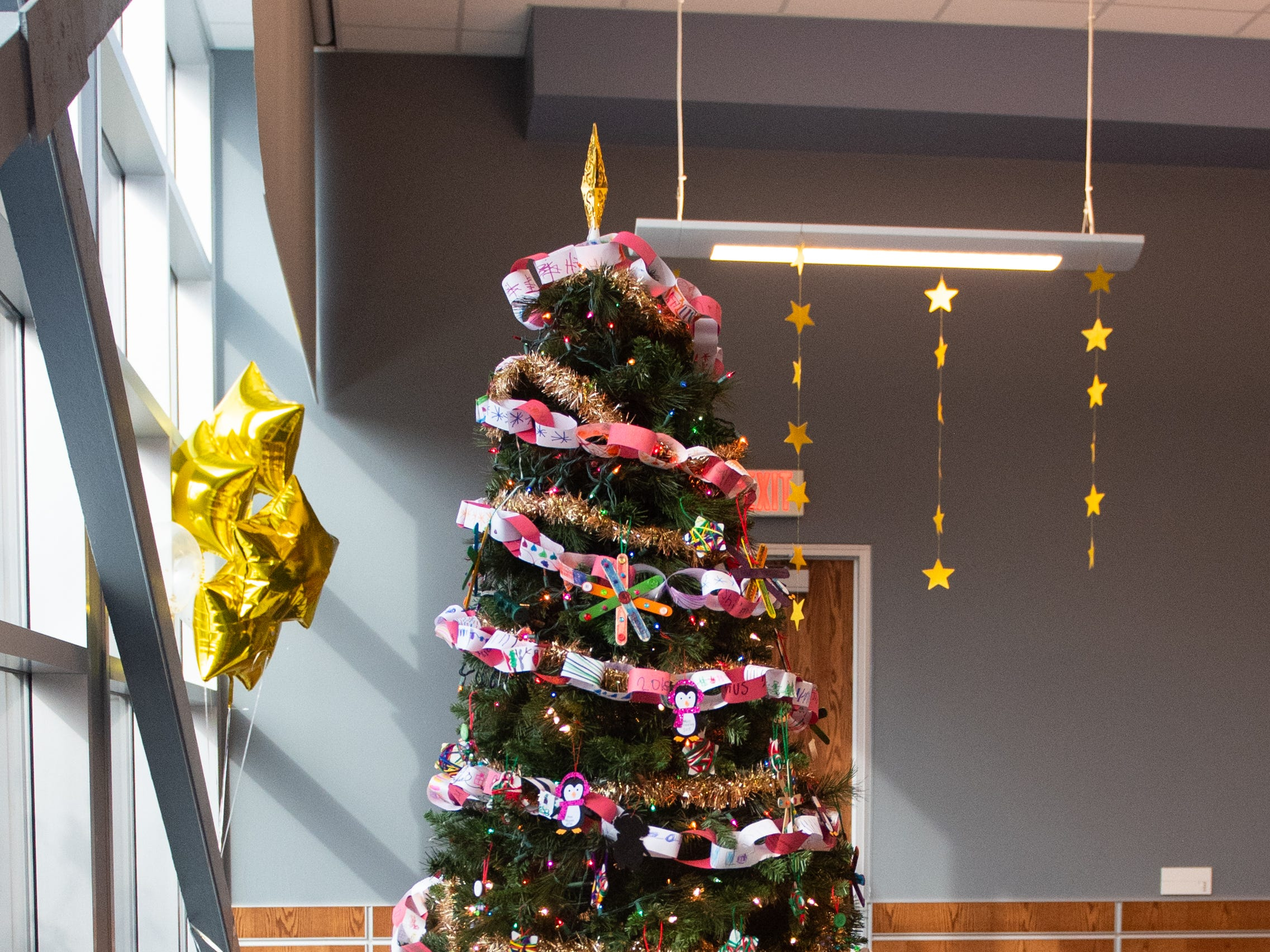 The Christmas tree at the back of the room is a popular site for pictures during the city of York's Shining Star Teacher Luncheon at the School District building, December 6, 2018.