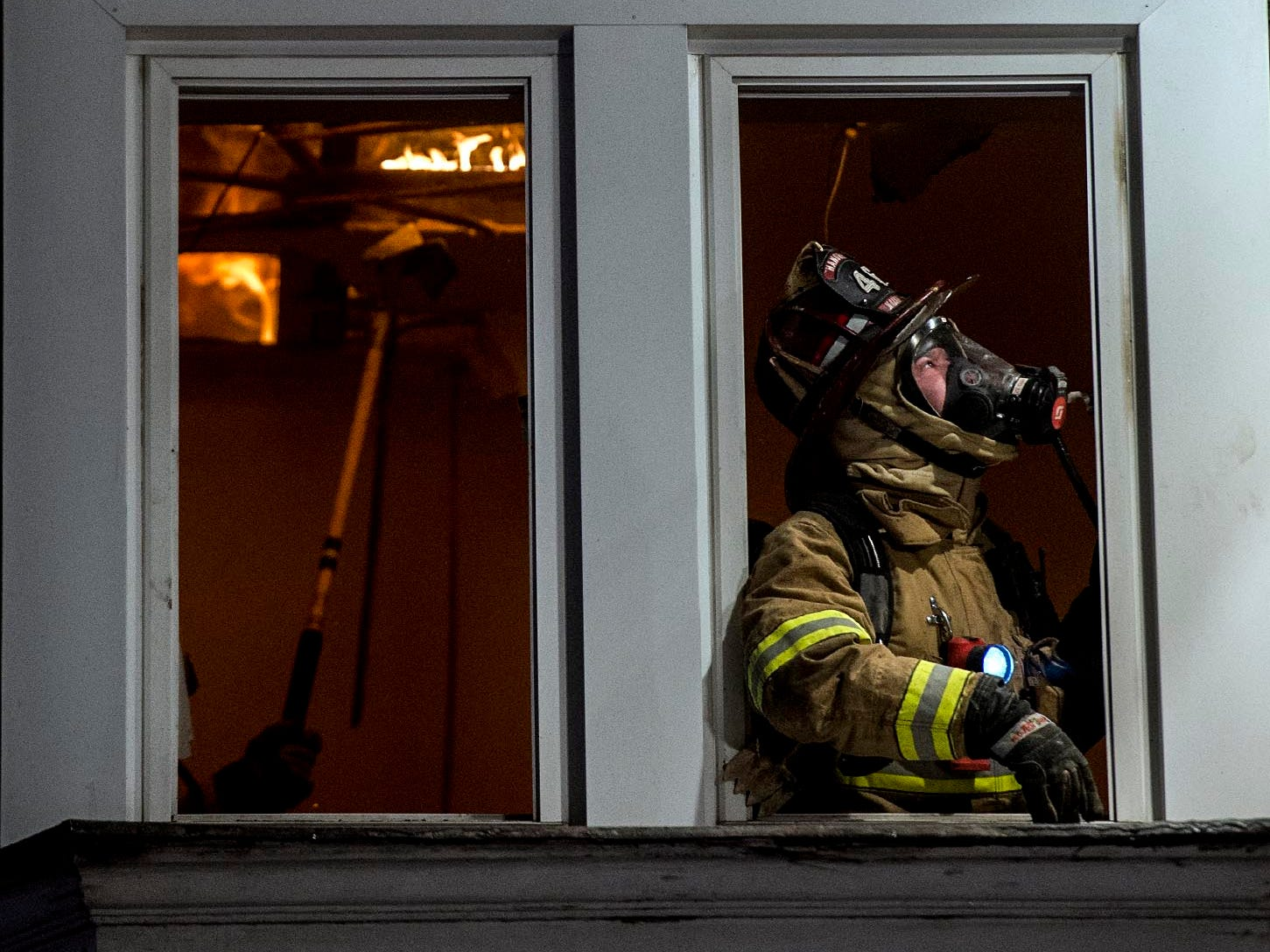 Fire fighters work on containing a house fire at 340 E. Walnut Street in Hanover Borough, Friday, February 2, 2018. Multiple families were displaced by the fire, which was dispatched at 1:28 a.m. Over 20 units responded to fight the blaze.