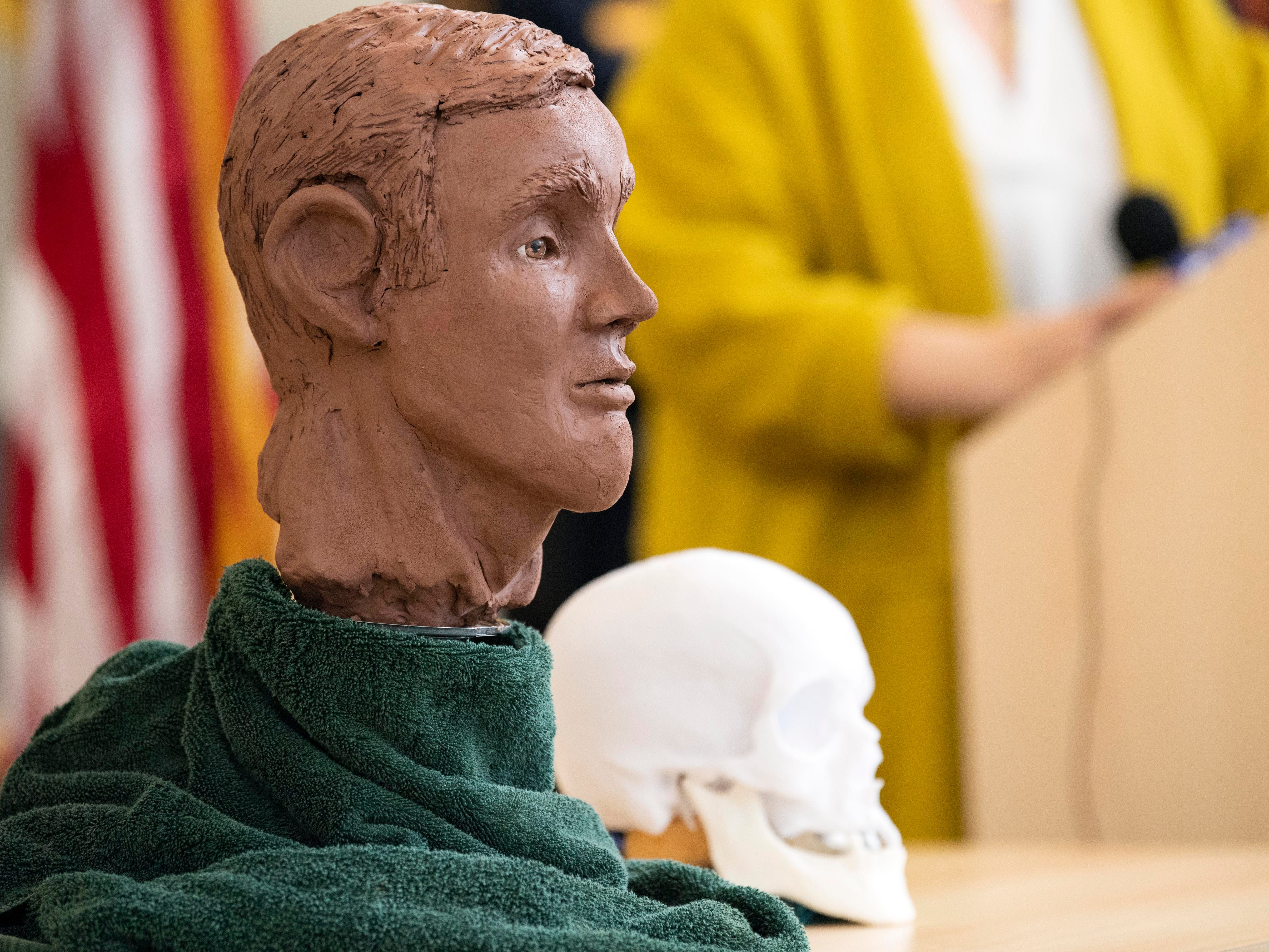 Forensic artist Jenny Kenyon speaks about her clay sculpture, showing what the victim of a 2013 cold case homicide might have looked like. It was displayed during a news conference to update the public on the still-unidentified remains found in West Manchester Township.