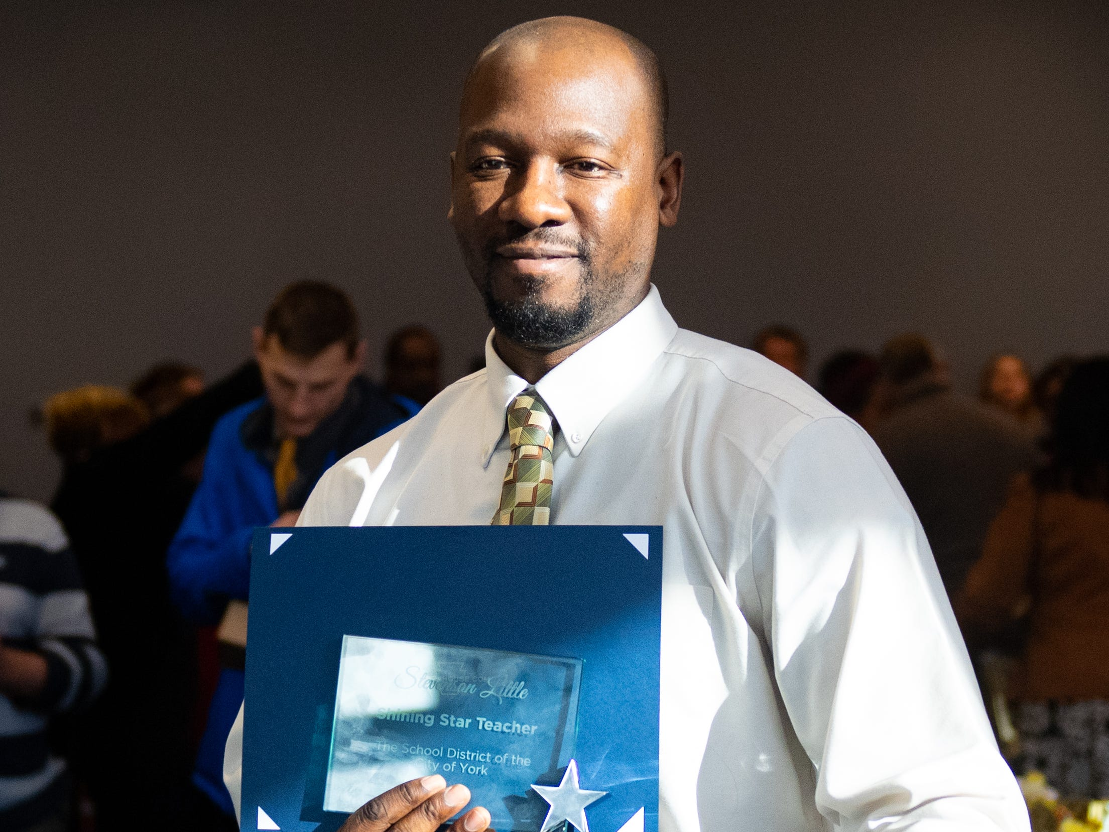 Steven Little, a teacher at Hannah Penn, poses with his Shining Star award during the city of York's Shining Star Teacher Luncheon at the School District building, December 6, 2018.