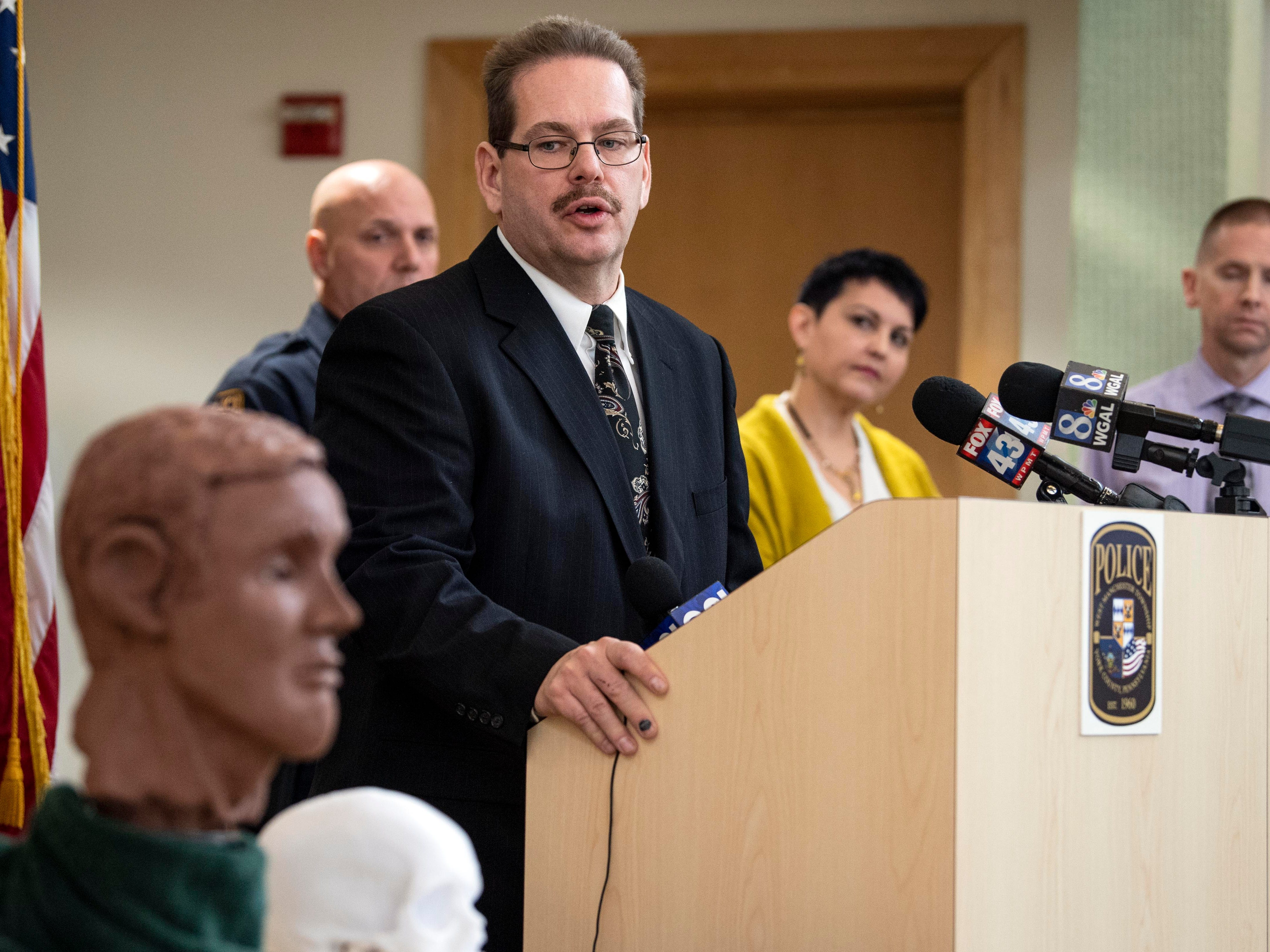 Officer Lance Krout, who is heading the investigation in the 2013 cold case, speaks about what is known about the victim, during a press conference on Thursday, Dec. 6, 2018. A forensic artists sculpted a clay bust and 3D-printed a skull to help show the public what the victim could've looked like.