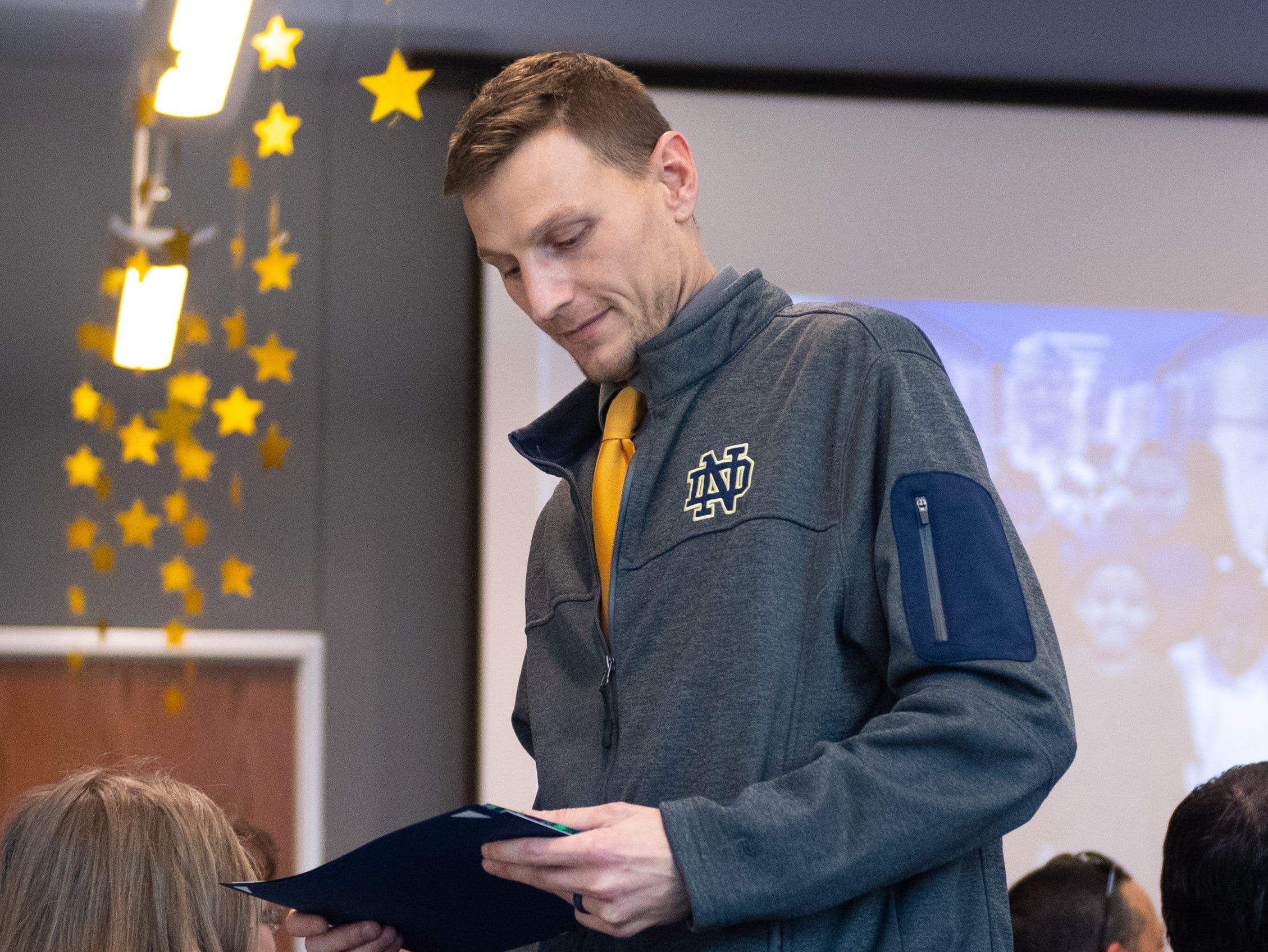 Nathaniel Leierer checks out his Shining Star award for his teaching at Davis, December 6, 2018.
