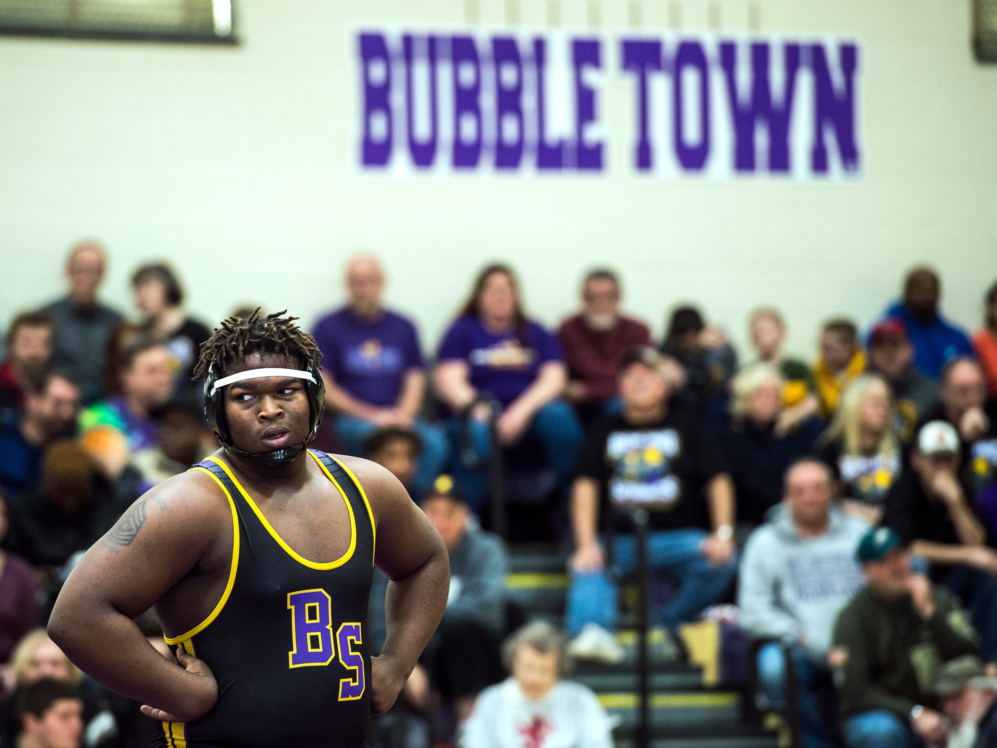 Boiling Springs' Damon James glances toward the Bermudian Springs' bench during the 285-pound bout. James won, 8-1, Saturday, Jan. 27, 2018. The Boiling Springs Bubblers beat the Bermudian Springs Eagles, 41-19 in the District 3 match.