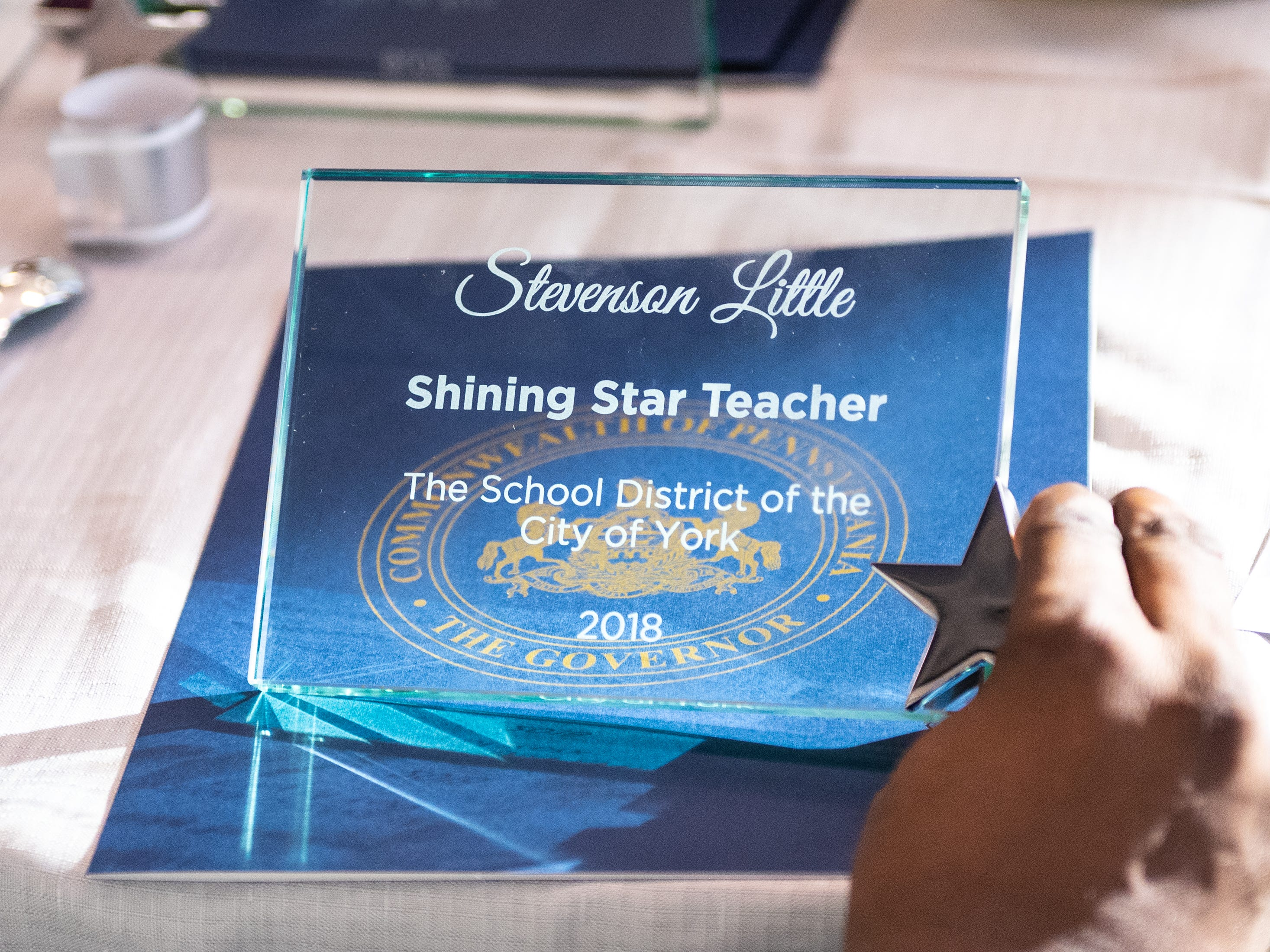 Each of the 35 teachers honored receive a clear plaque that stands up on a desk, December 6, 2018.