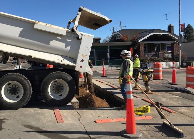 Crews work to replace utility infrastructure Dec. 3, 2018 on South Virginia Street in Midtown Reno. It's part of a project that will continue into 2020.