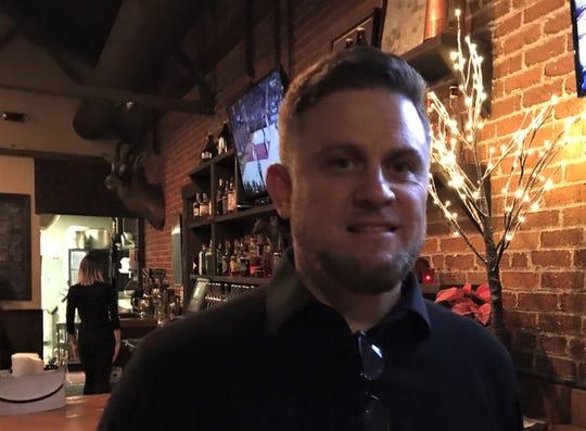 Chris Schiavone of The Saint James Group, poses at Brasserie Saint James in Midtown Reno on Dec. 5, 2018.