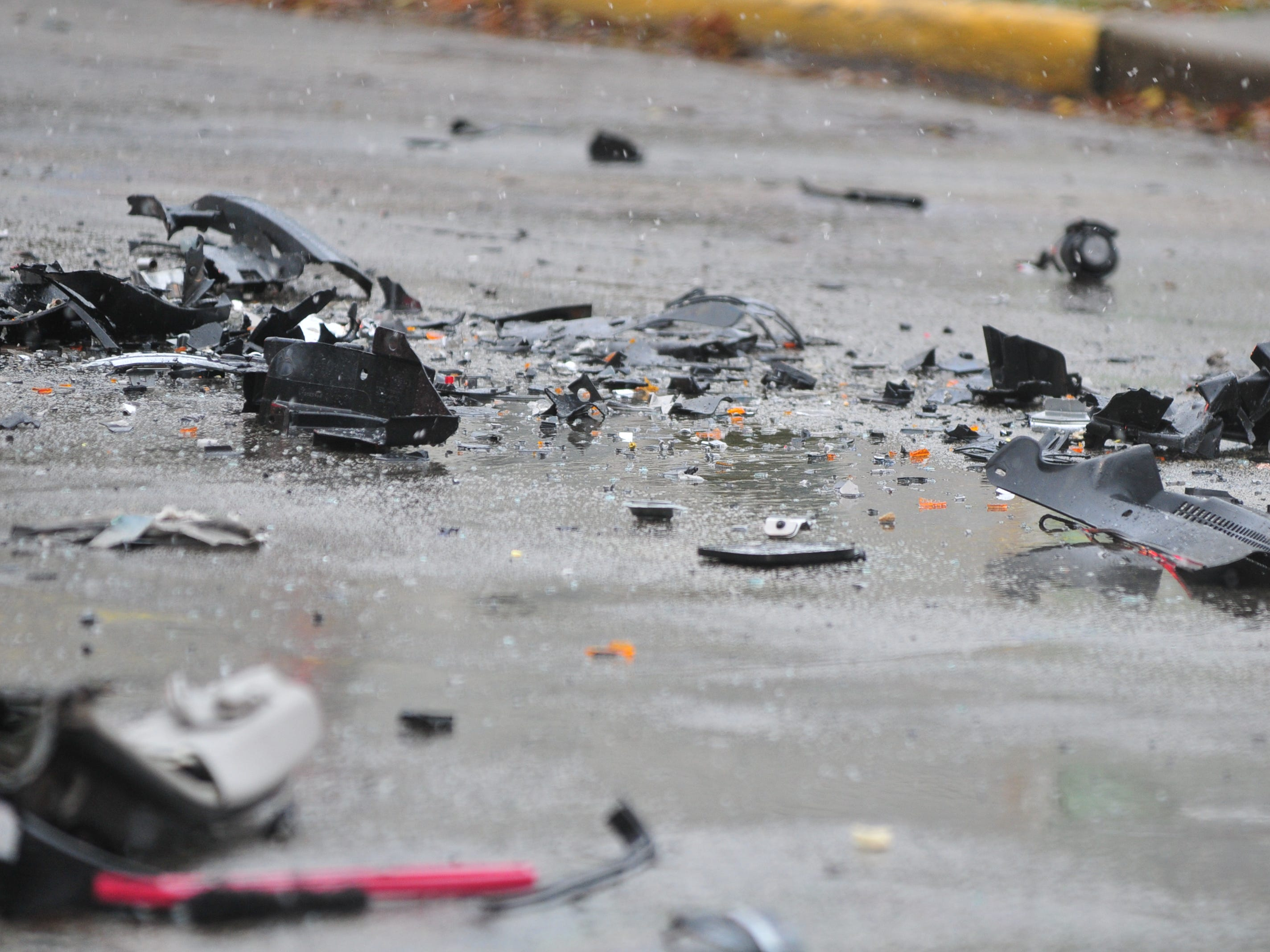 Debris from an accident litters Richmond Avenue on Thursday.