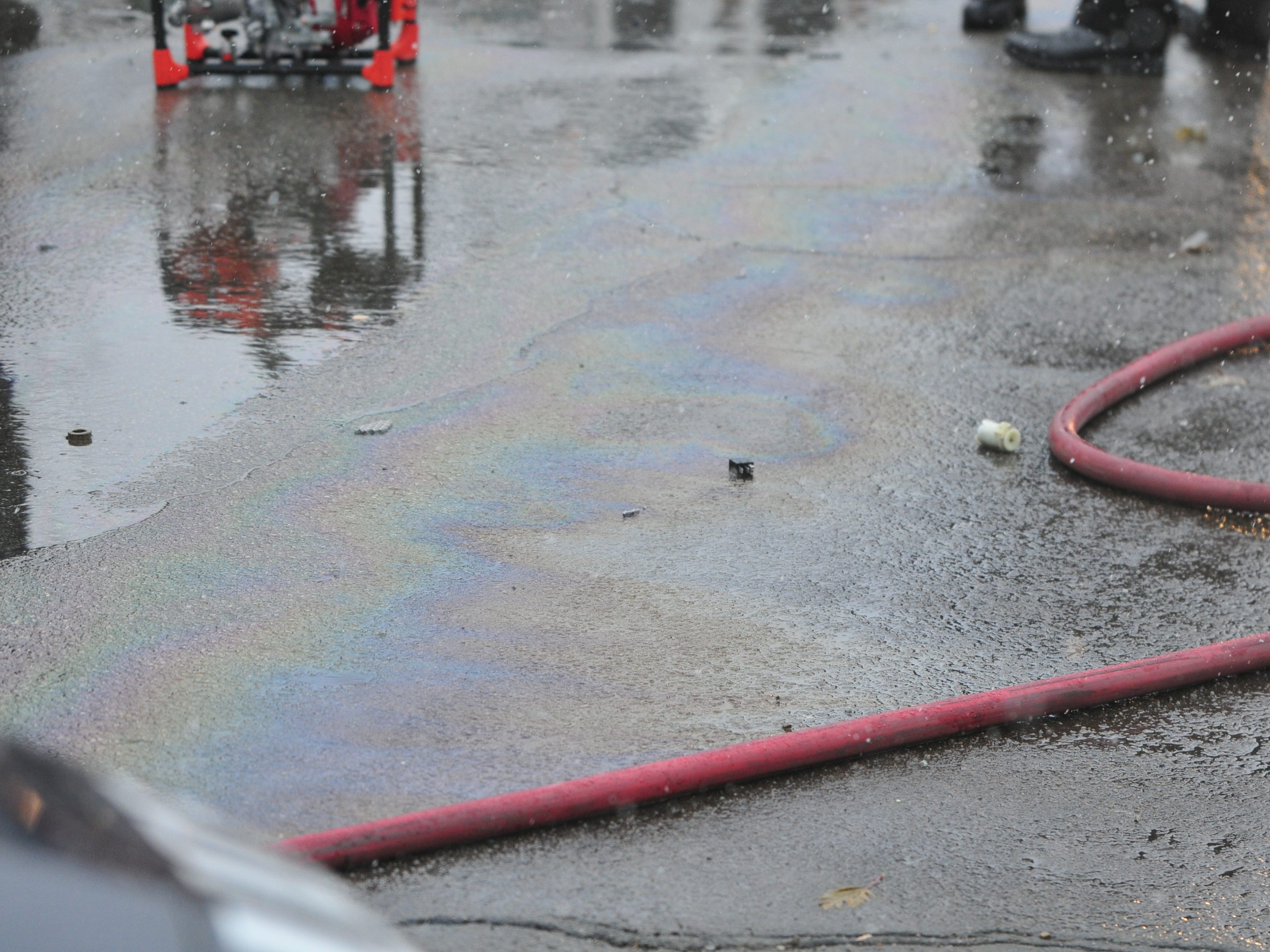 Fluids make a colorful pattern on a wet Richmond Avenue after an accident Thursday.