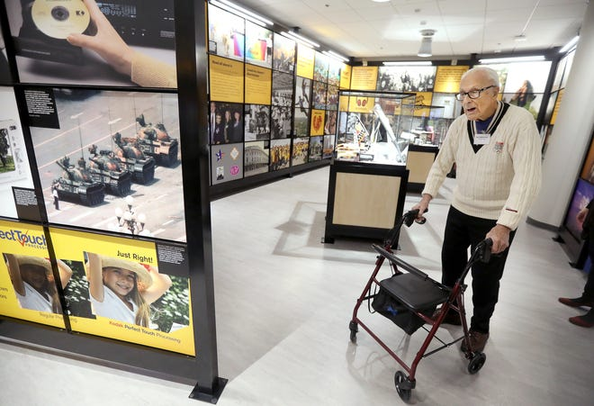 Kodak retiree and former photographer Neil Montanus, 91, walks through the exhibits during the Kodak Visitor Center Grand Opening. Montanus shot 55 of the 565 Coloramas throughout the years for the company, with some printed samples on display at the center.