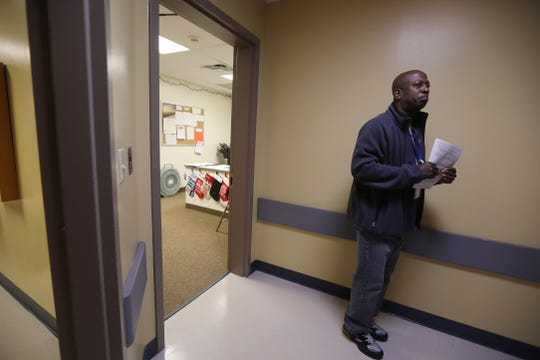 Howard Henry, Access associate at Rochester Regional Health Behavioral Health Access & Crisis Center at St. Mary's Campus,  looks down the hall at a coworker to give her some forms.  The crisis center is located on the Chili Ave. side of St. Mary's Campus.